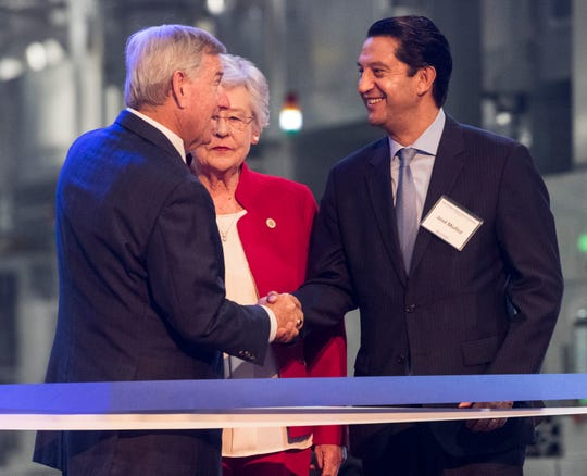 Mayor Todd Strange, from left, Gov. Kay Ivey and Hyundai Global COO Jose Munoz chat during the new engine plant grand opening at the Hyundai plant in Montgomery, Ala., on Wednesday, May 15, 2019.