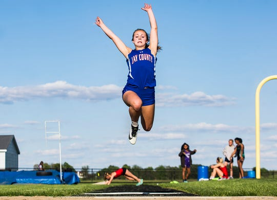 Jay County's Halle Hill competes in the long jump during the girls track sectional at Delta High School Tuesday, May 14, 2019.