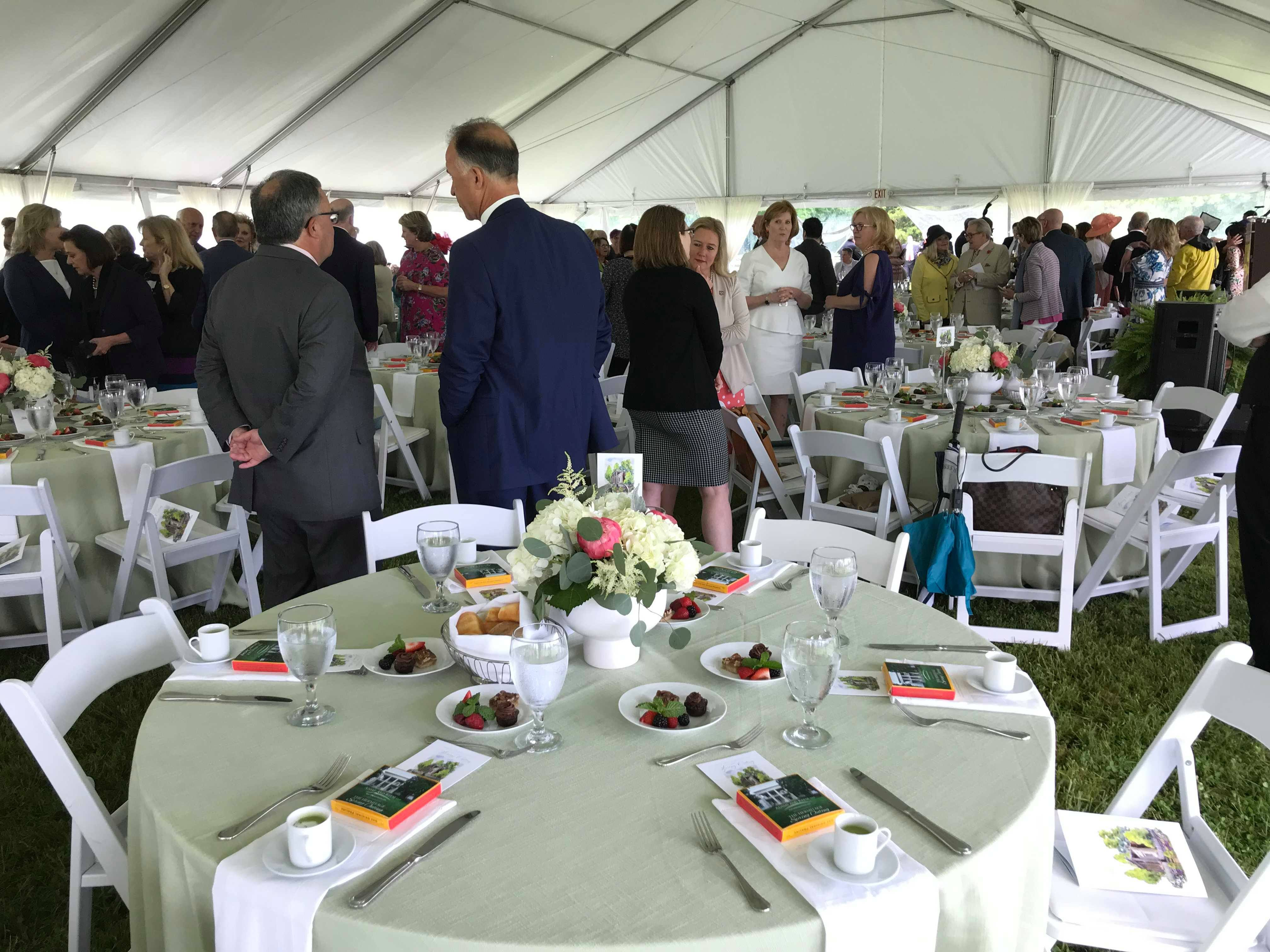 Attendees of the Spring Outing fundraising event mingle Wednesday at The Hermitage.