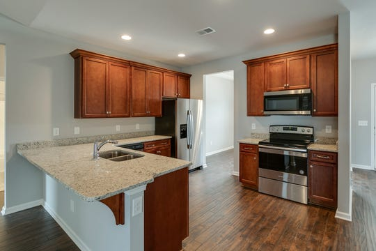 The homes feature granite countertops, stainless appliances and laminate wood floors.
