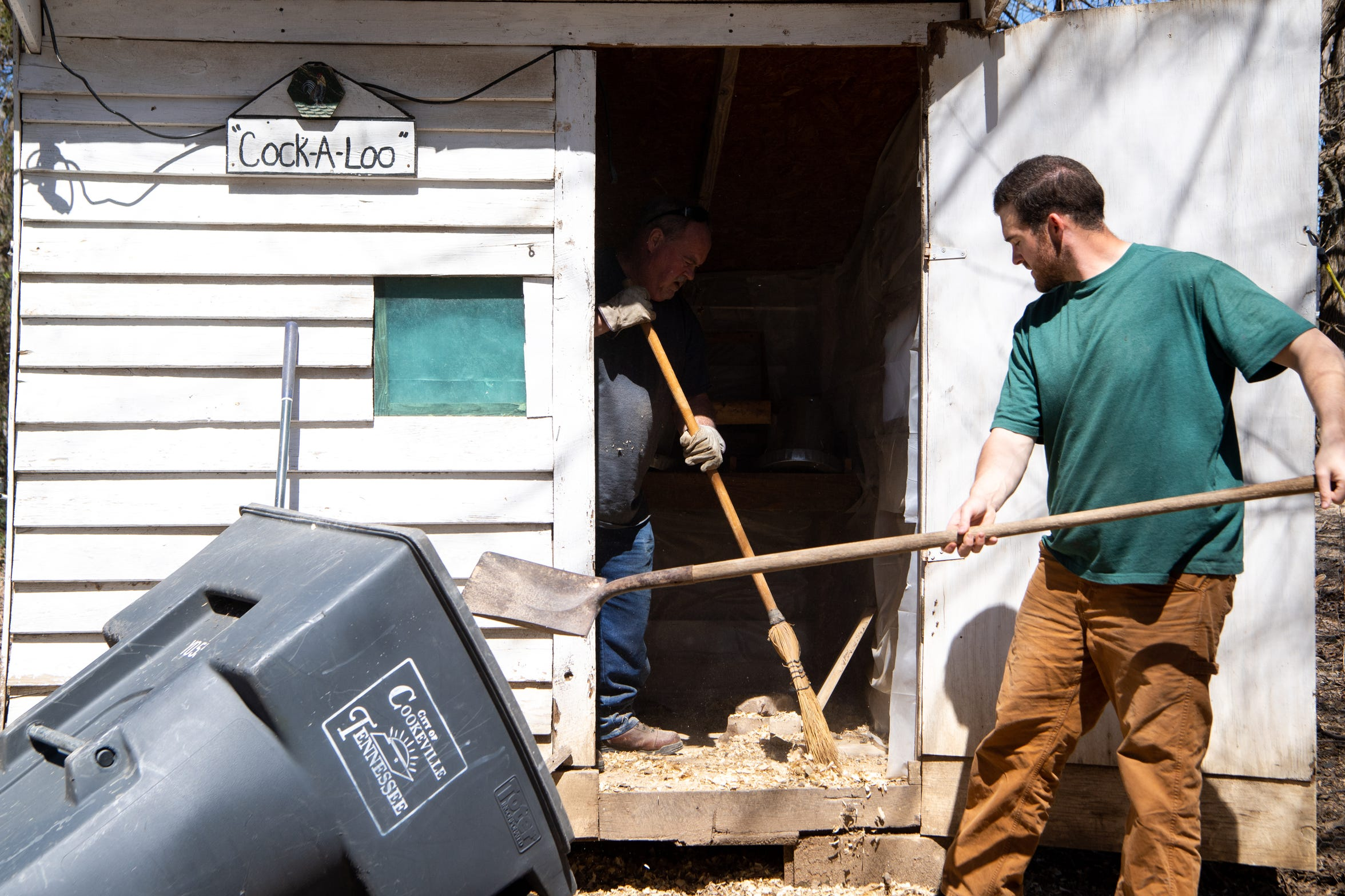 Larry Elmore and his son, Justin, clean a chicken coop on the Cookeville, Tenn., farm of Dr. Sam Barnes on March 23, 2019. Addiction once eroded their relationship, but it has been rebuilt since Elmore went to rehab.