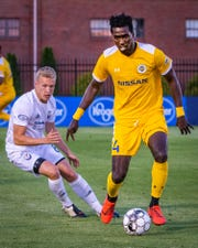 Nashville SC midfielder Derrick Jones dribbles the ball during Nashville's 3-2 win over South Georgia Tormenta FC 2 on May 14, 2019.