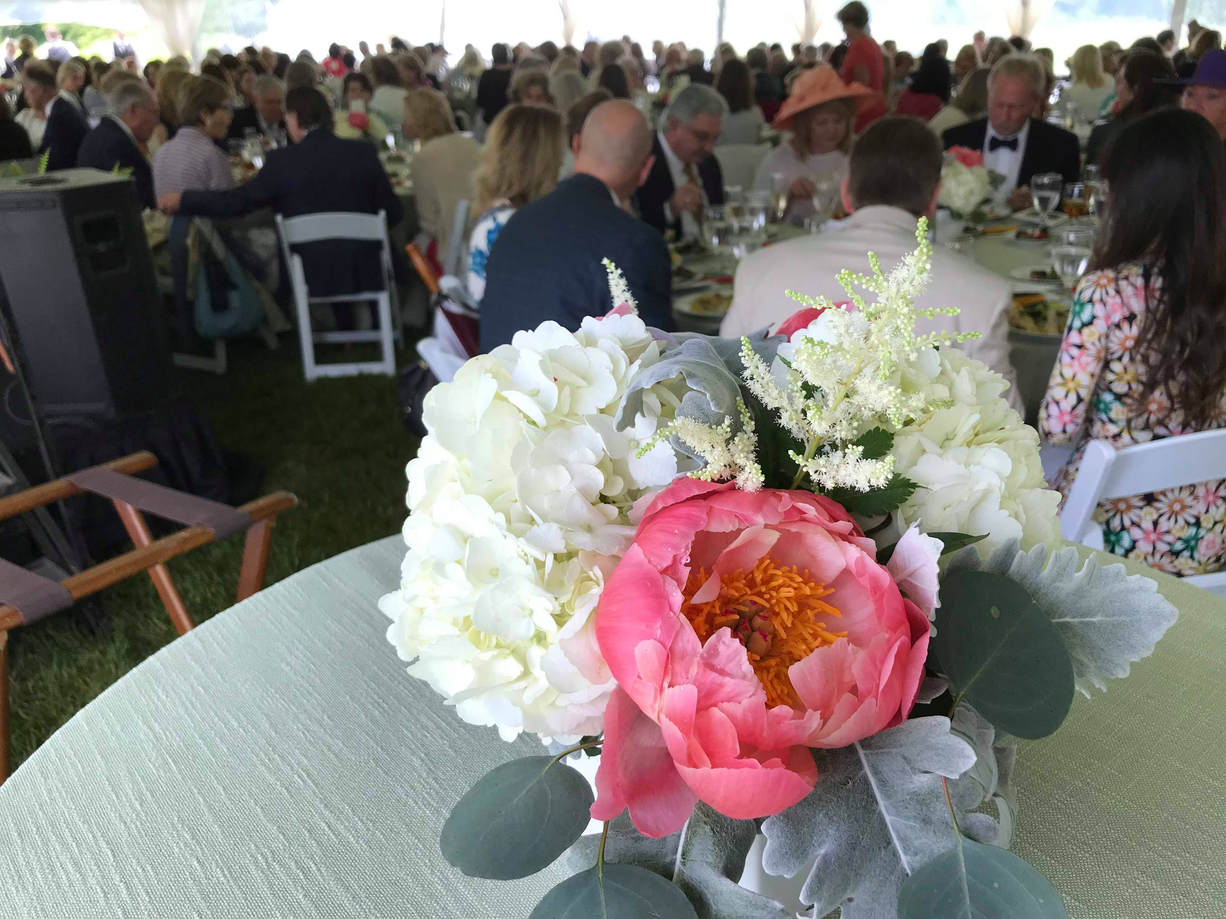 Attendees of the Spring Outing event eat their meals while waiting for the keynote address on Wednesday at The Hermitage.