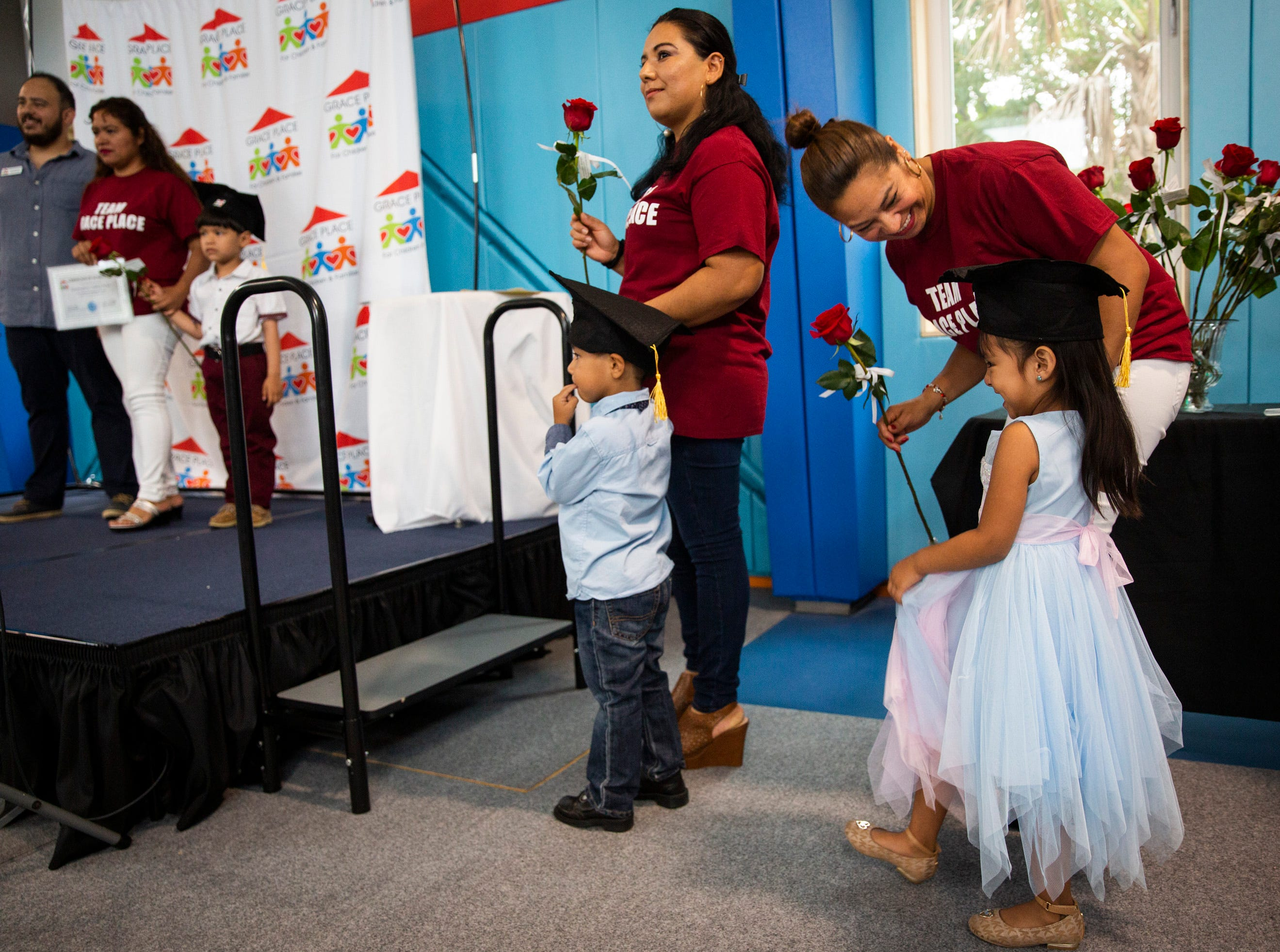 Adriana Flores, right, laughs with her daughter Alexa Flores, 3, during the Bright Beginnings family literacy program graduation at Grace Place in Golden Gate on Wednesday, May 15, 2019.