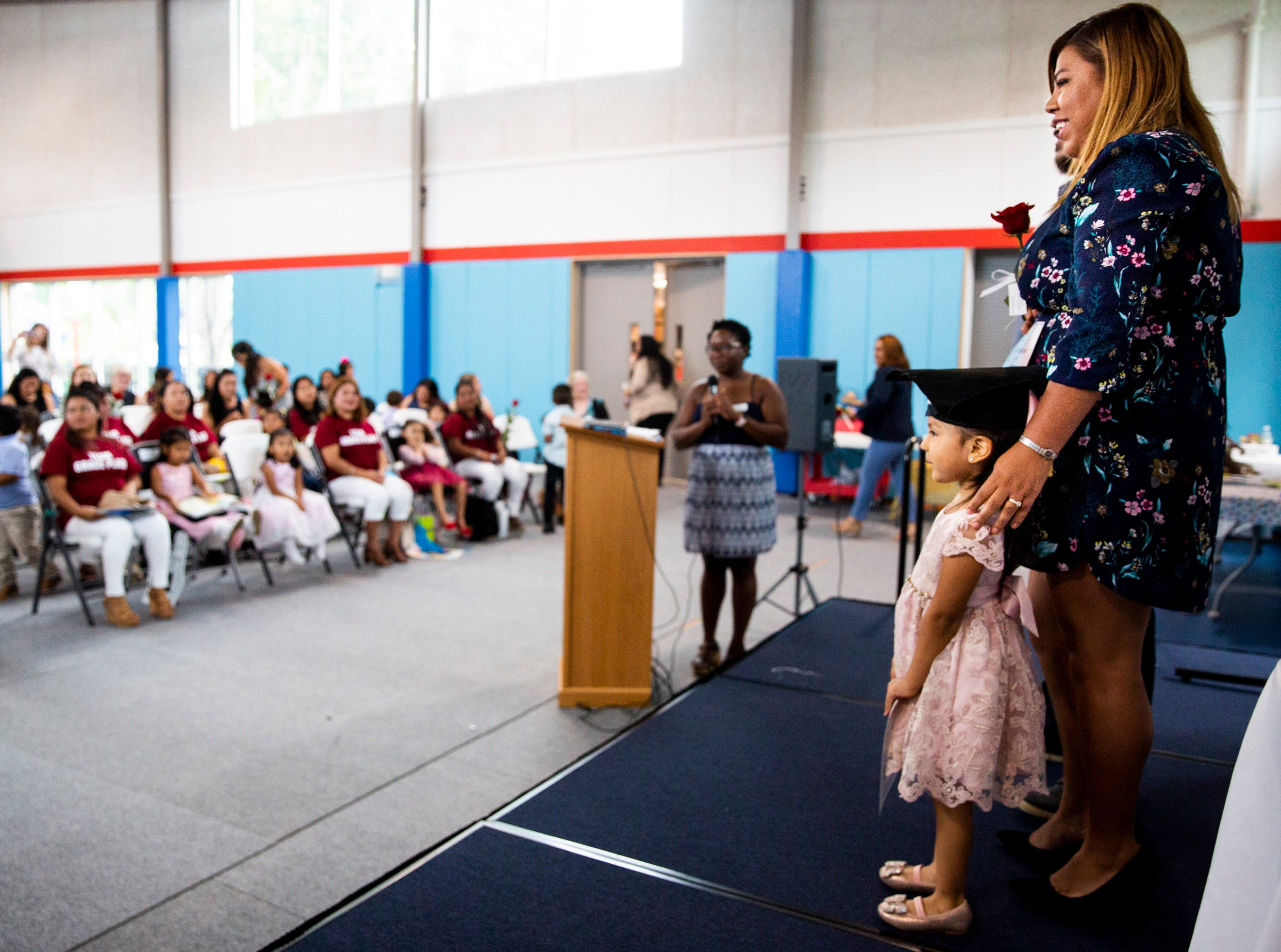 Berenice Garcia and her daughter Vanessa Perez, 3, pose for a photo during the Bright Beginnings family literacy program graduation at Grace Place in Golden Gate on Wednesday, May 15, 2019. Garcia has been attending classes through the program for the past six years.