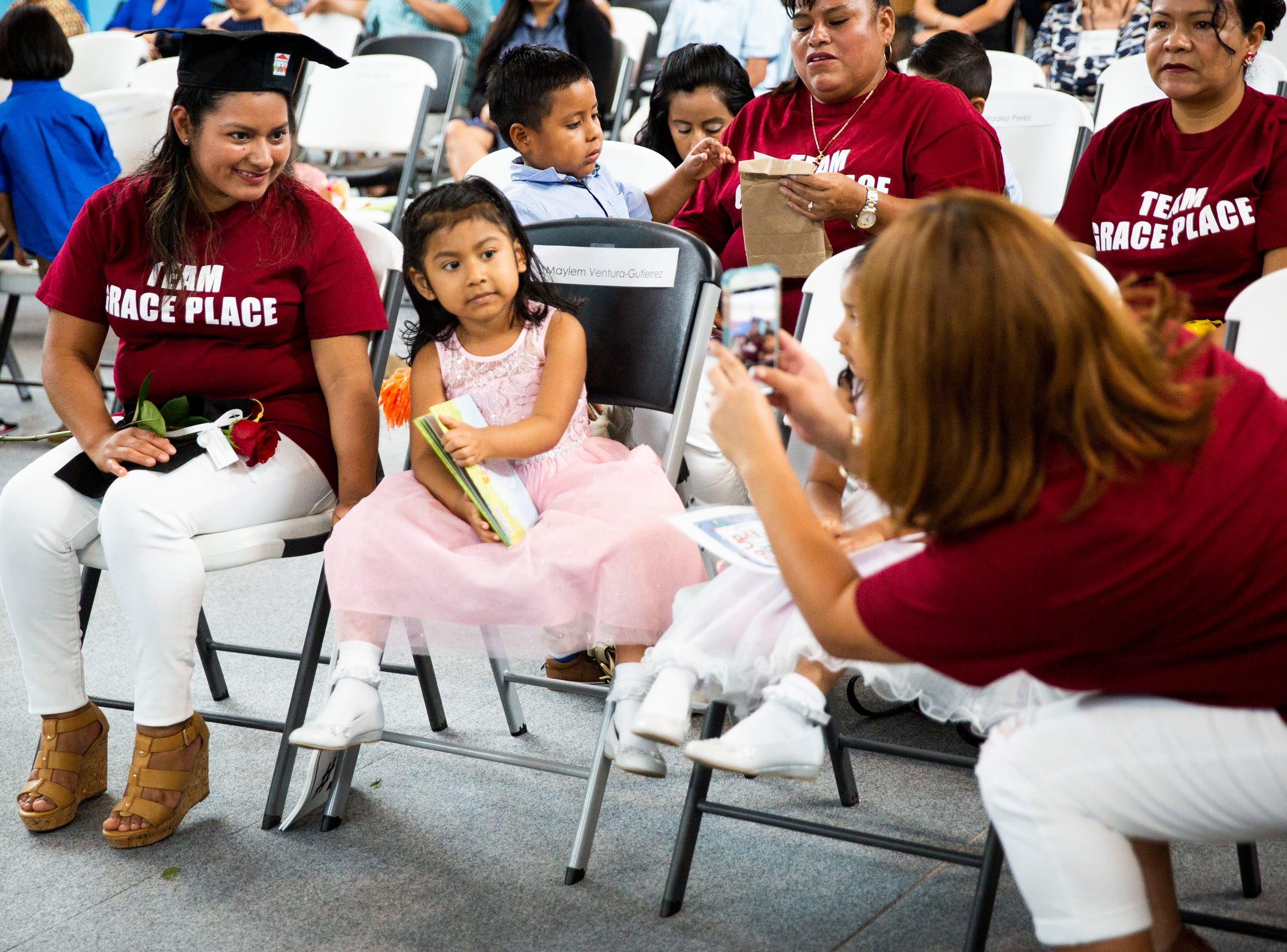 Veronica Gutierrez, left, and her daughter Maylem Ventura-Gutierrez pose for a photo during the Bright Beginnings family literacy program graduation at Grace Place in Golden Gate on Wednesday, May 15, 2019.