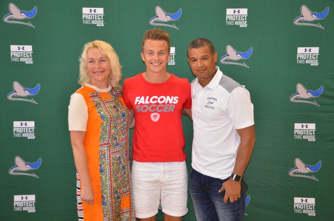 Seacrest's Lukas Pusinskas signed his letter of intent to play college soccer at Friends University, an NAIA school in Wichita, Kansas. Pusinskas, originally from Lithuania, played three seasons at Seacrest and set the all-time school record with 76 goals. With him at the ceremony are his mother Rita and Seacrest coach Paul Williams.