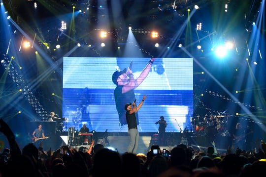 """Chris Bradshaw/Special to the Daily NewsCountry music star Luke Bryan performs to a sold out crowd at Germain Arena in Estero on January 25, 2013. His current Dirt Road Diaries Tour, his first headlining tour, in support of his platinum 2011 album """"Tailgates & Tanlines,"""" continues for the rest of the year including stops in Tampa and West Palm Beach in October. In 2012, Bryan won a record nine American Country Awards and an American Music Award for Favorite Male Country Artist. He will co-host the 48th Annual Academy of Country Music Awards in April. The opening acts on his tour are Florida Georgia Line and Thompson Square."""