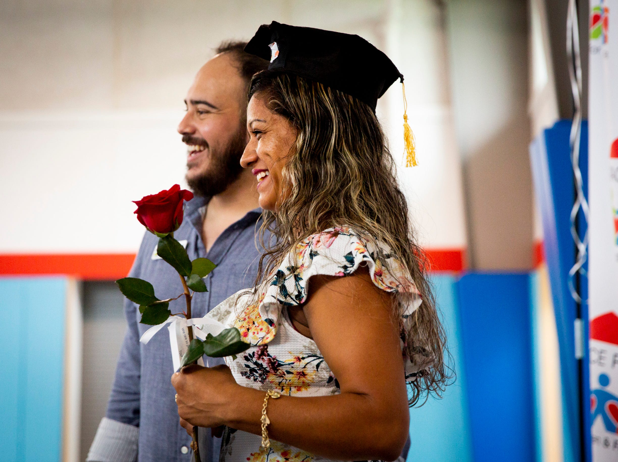 Emma Mireles, right, smiles as she poses for a photo with Oscar Rodriguez during the Bright Beginnings family literacy program graduation at Grace Place in Golden Gate on Wednesday, May 15, 2019.