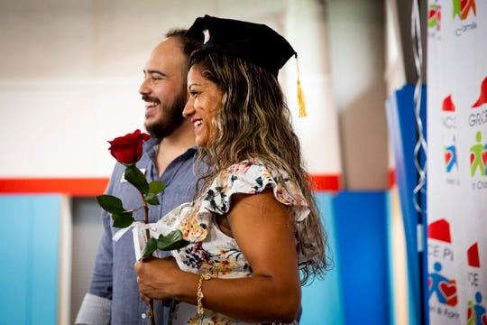 Emma Mireles, right, smiles as she poses for a photo with Oscar Rodriguez, adult education program manager, during the Bright Beginnings family literacy program graduation at Grace Place in Golden Gate on Wednesday, May 15, 2019.