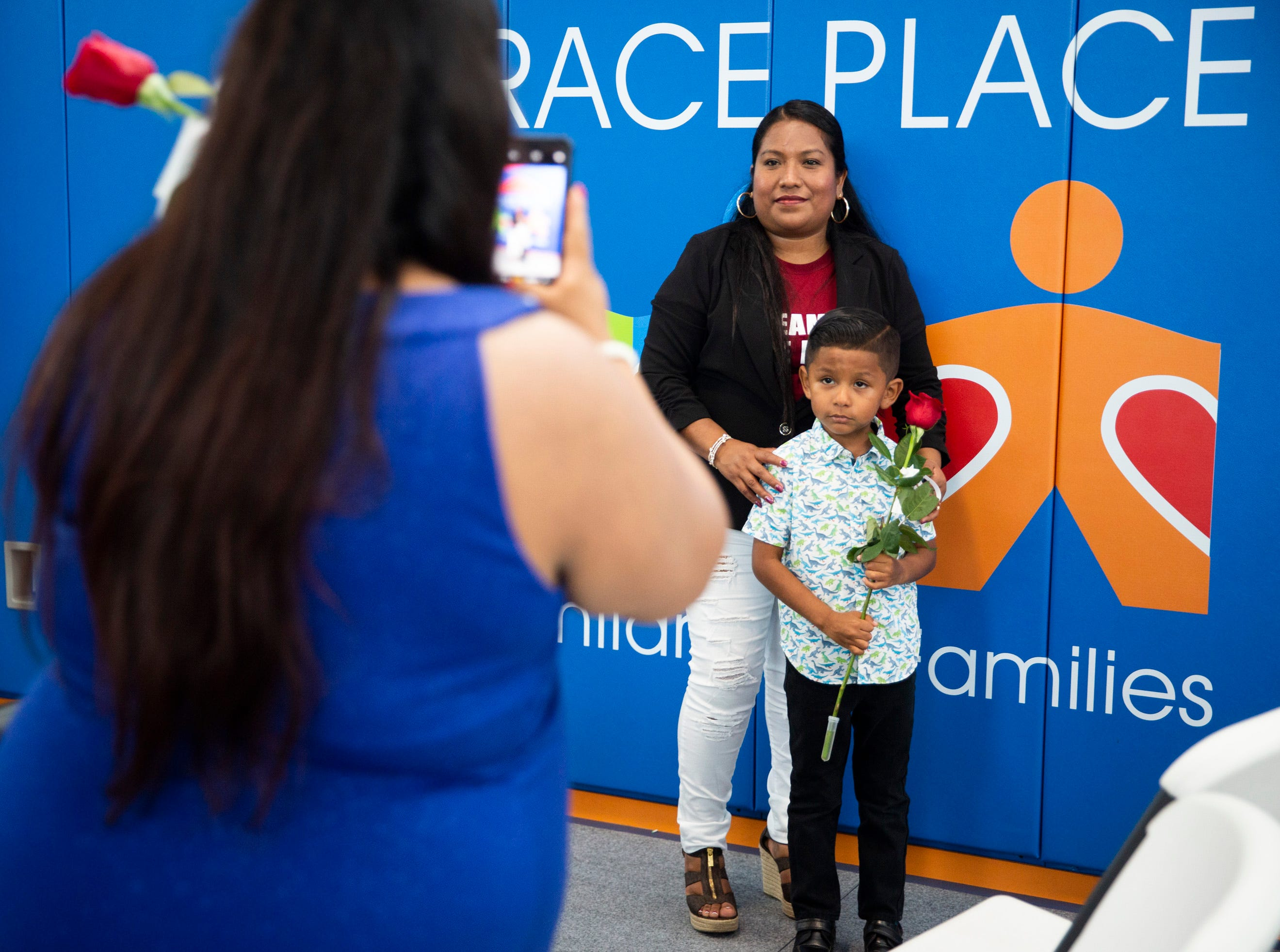 Maria Manuel poses for a photo with her son Gaell Sanchez, 5, during the Bright Beginnings family literacy program graduation at Grace Place in Golden Gate on Wednesday, May 15, 2019.