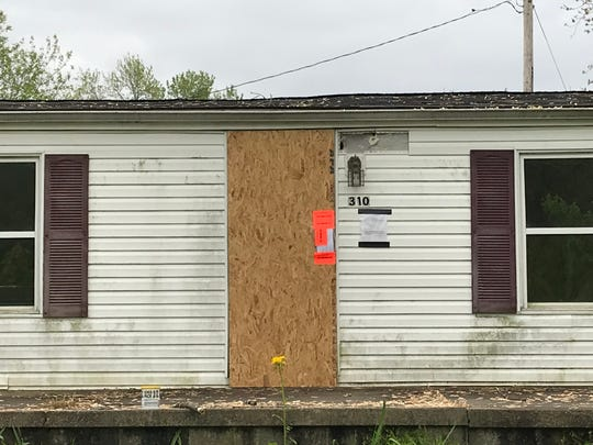 A house at 310 Seymour Ave. in Buckeye Lake sits empty and boarded up. Buckeye Lake officials said the property was acquired by Licking County Land Bank, but is still working to acquire the building.