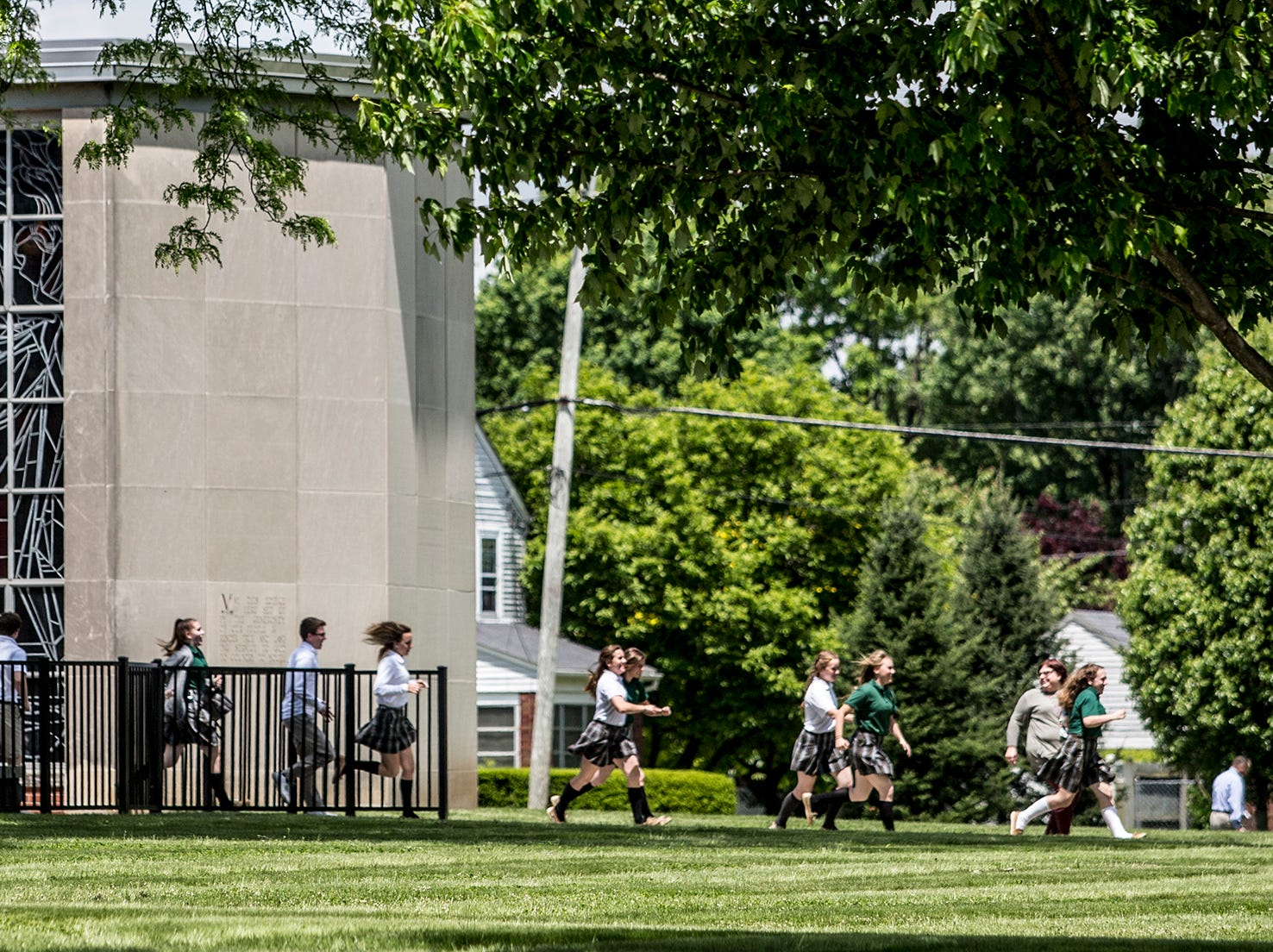 Newark Catholic students run from their school to Wilson Middle School during an active shooter drill Wednesday afternoon.