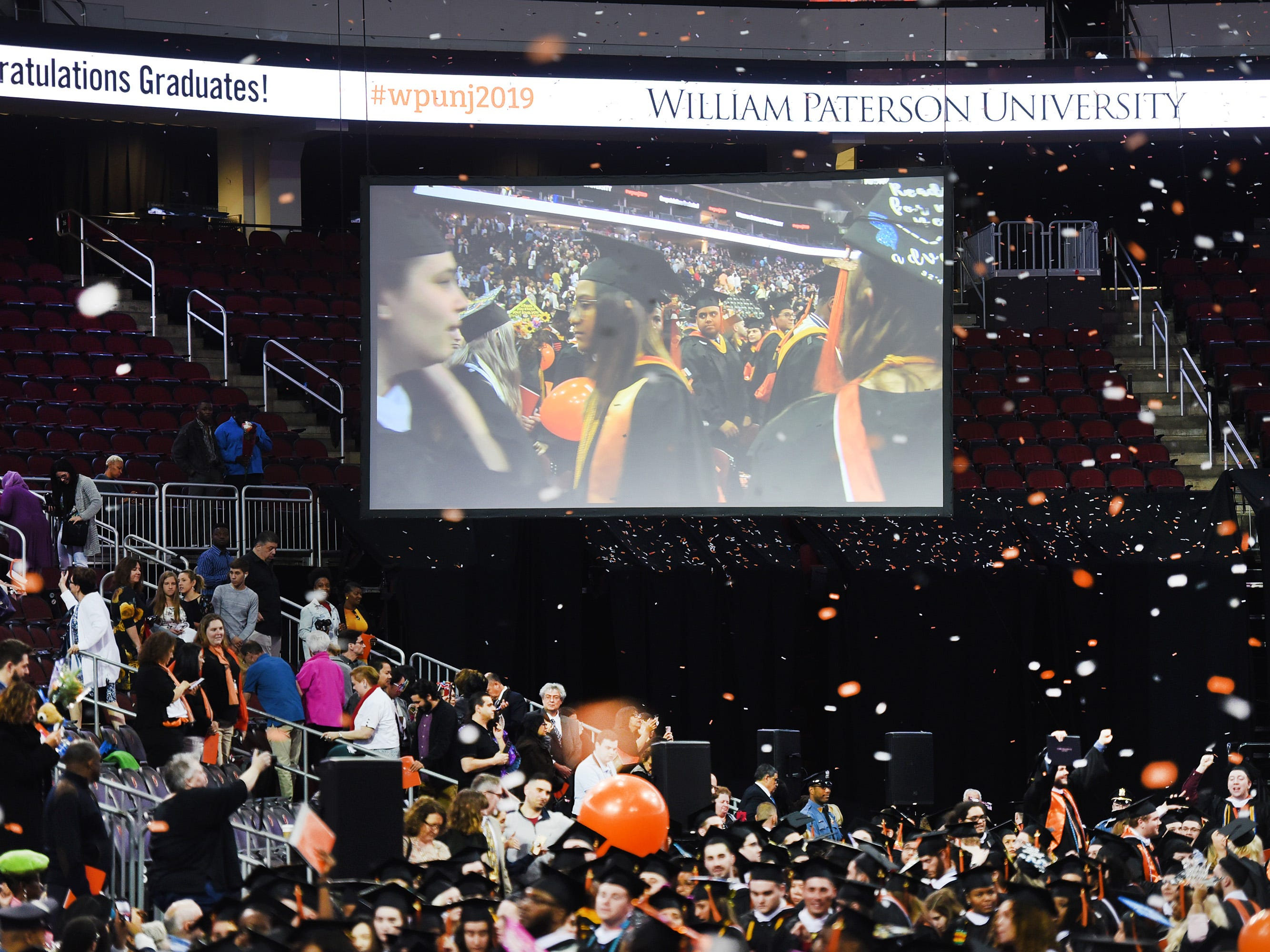 Confetti rains down on the graduates during the William Paterson University 2019 Commencement at the Prudential Center in Newark on 05/15/19.