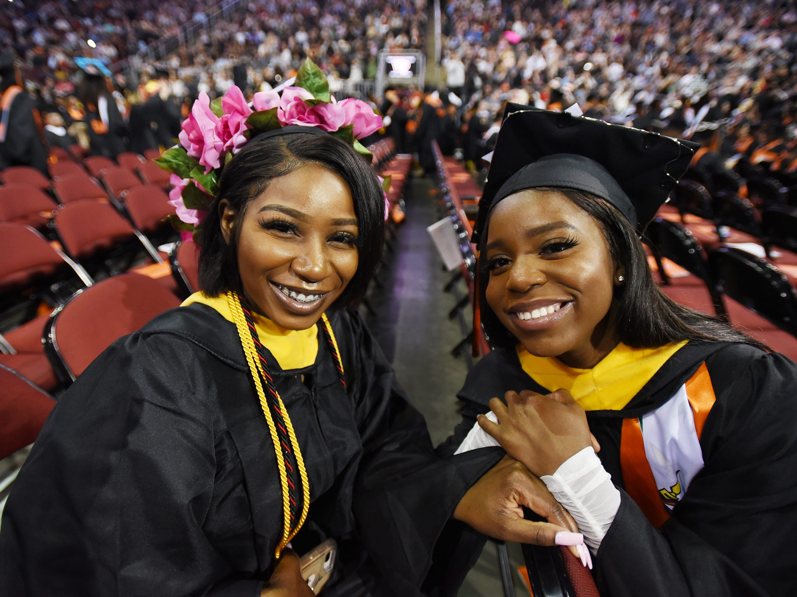 Photo of Sofia Philogene (L) of Hillside, Major in Exercise Science and Christy Demosthenes (R) of Hillside, Major in Health Studies, pose for photos during the William Paterson University 2019 Commencement at the Prudential Center in Newark on 05/15/19.