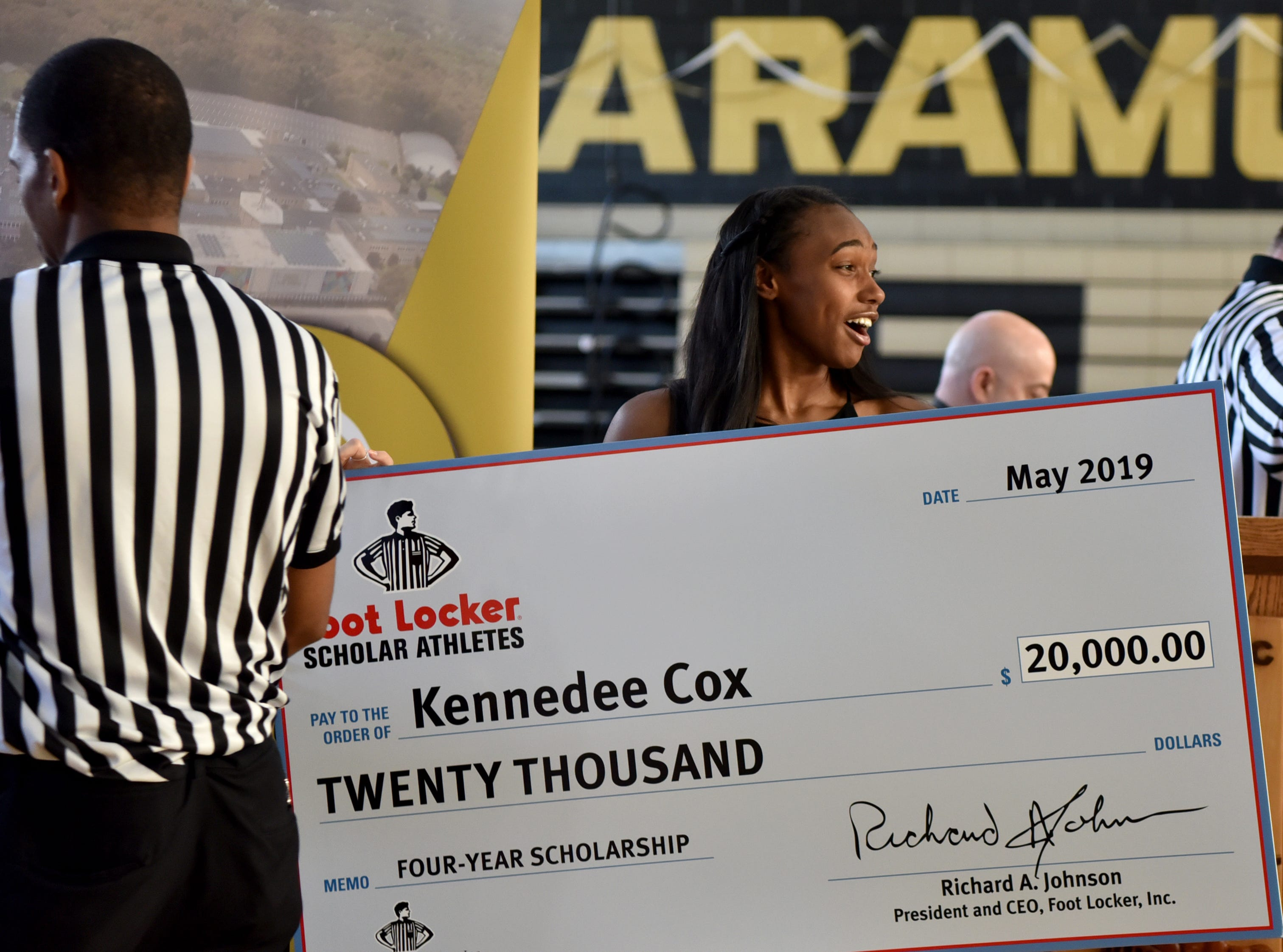 Paramus Catholic senior Kennedee Cox poses for a picture with her $20,000 check from the Foot Locker Scholar Athletes Program. Cox, of Teaneck, runs track at Paramus Catholic. Foot Locker representatives surprised Cox with the announcement at school on Wednesday, May 15, 2019.