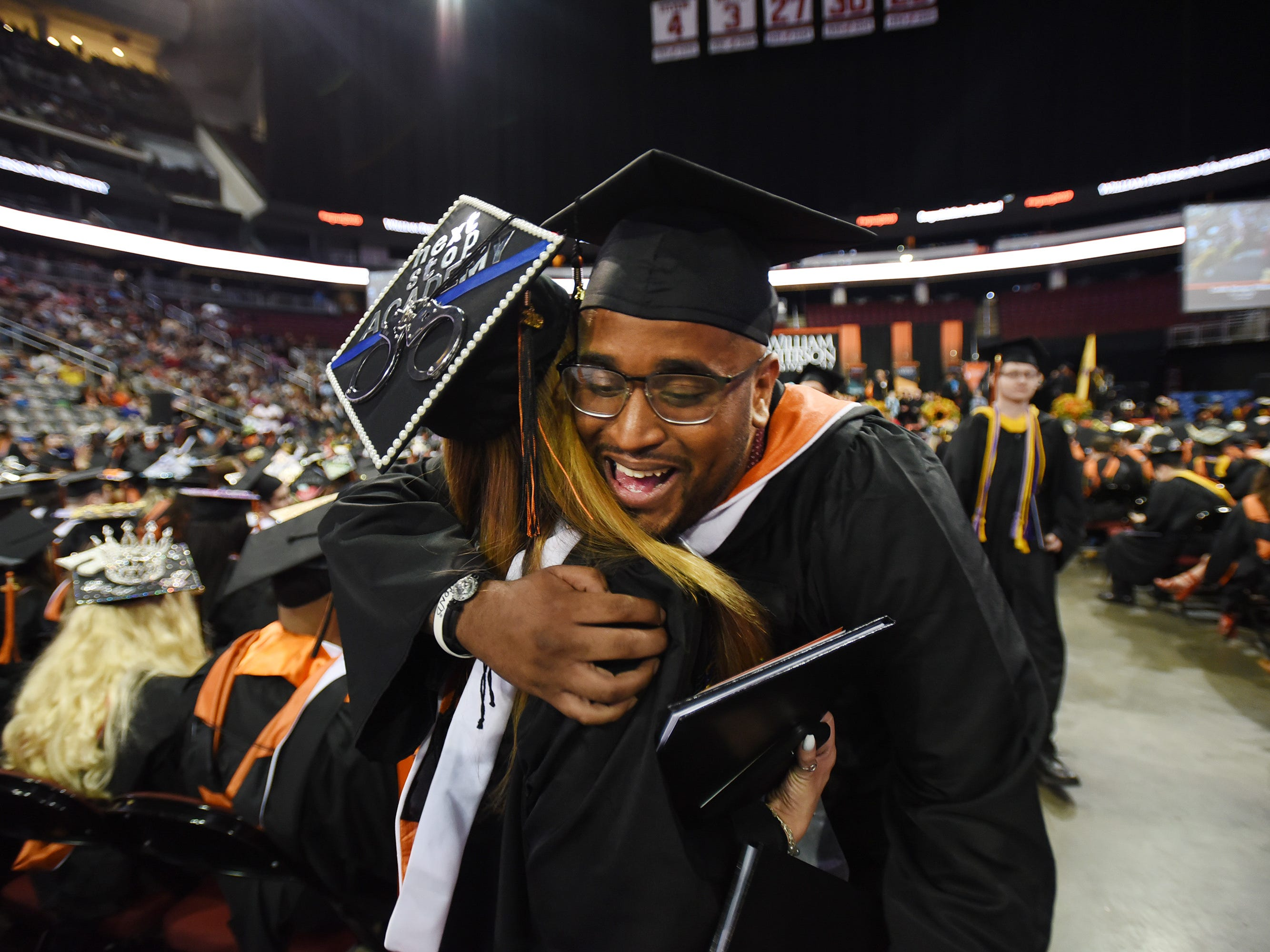 Micah Seerattan of Teaneck, Major in Sociology, receives a hug from a friend during the William Paterson University 2019 Commencement at the Prudential Center in Newark on 05/15/19.