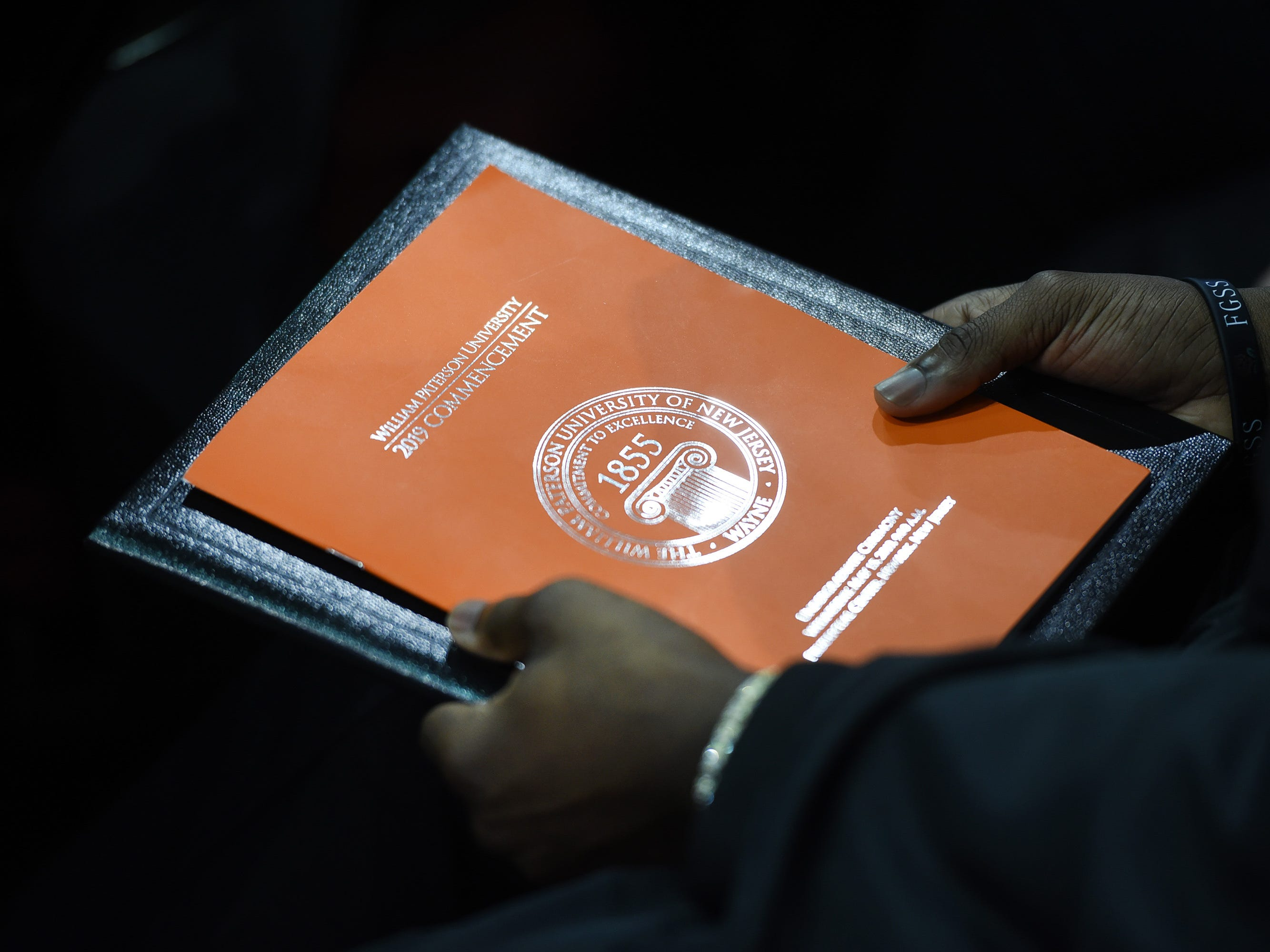 Close up of the program is held by a graduate during the William Paterson University 2019 Commencement at the Prudential Center in Newark on 05/15/19.