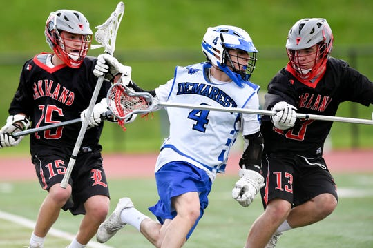 Demarest's Travis Hinds (4) drives to the goal with pressure from Lakeland defenders Jake Ryan (15) and Jake Devore (13). Northern Valley Demarest defeated Lakeland 6-3 in the first round of the North Group 2 boys lacrosse tournament on Wednesday, May 15, 2019 in Demarest, NJ.
