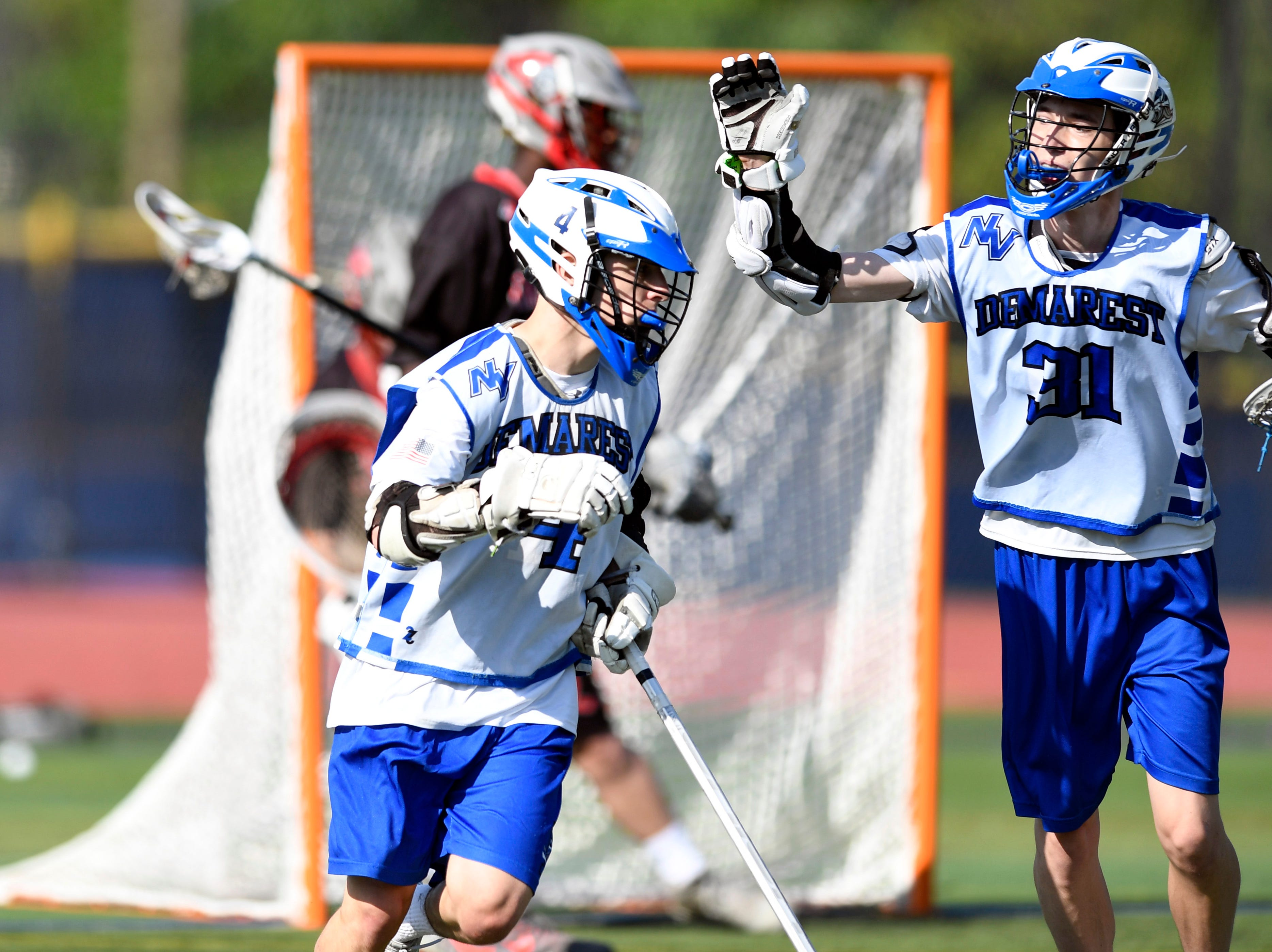 Demarest's Travis Hinds, left, and Matt Pluzsik celebrate Hinds' goal against Lakeland. Northern Valley Demarest defeated Lakeland 6-3 in the first round of the North Group 2 boys lacrosse tournament on Wednesday, May 15, 2019 in Demarest, NJ.