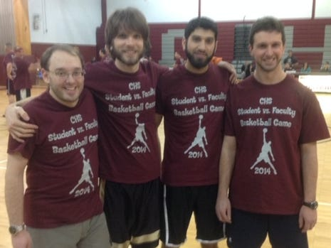 Clifton High School biology teacher Steven Meck, second from left, died suddenly Friday. He's pictured with friends at a student, faculty basketball game in 2014.