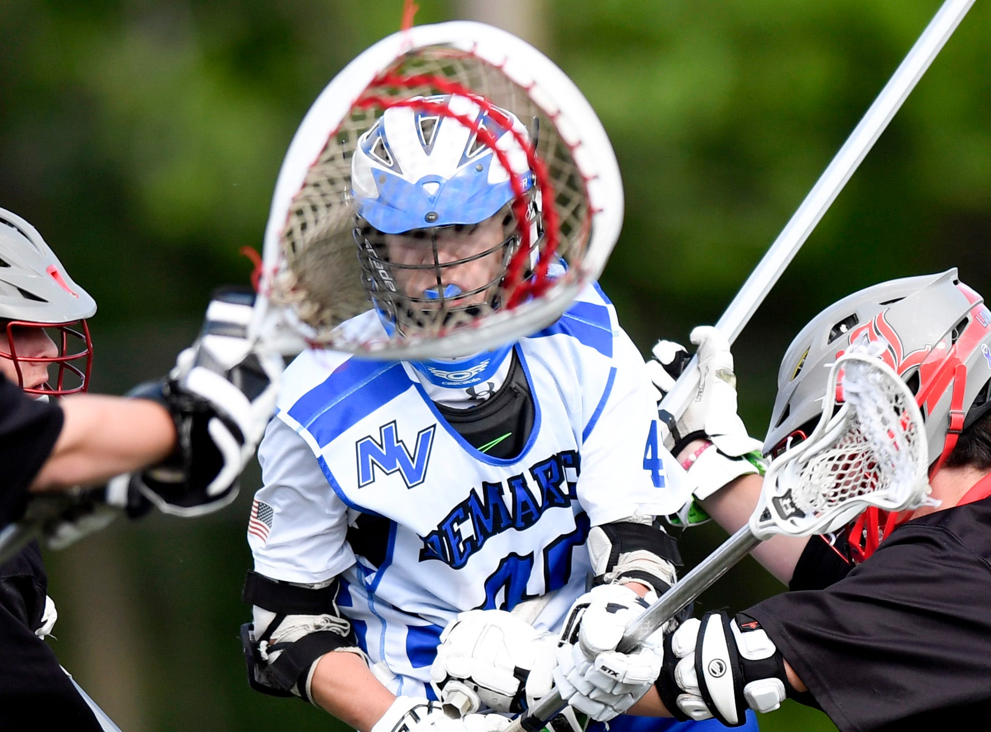 Demarest's Logan Hinds, center, attempts a shot on goal with pressure from Lakeland defenders. Northern Valley Demarest defeated Lakeland 6-3 in the first round of the North Group 2 boys lacrosse tournament on Wednesday, May 15, 2019 in Demarest, NJ.