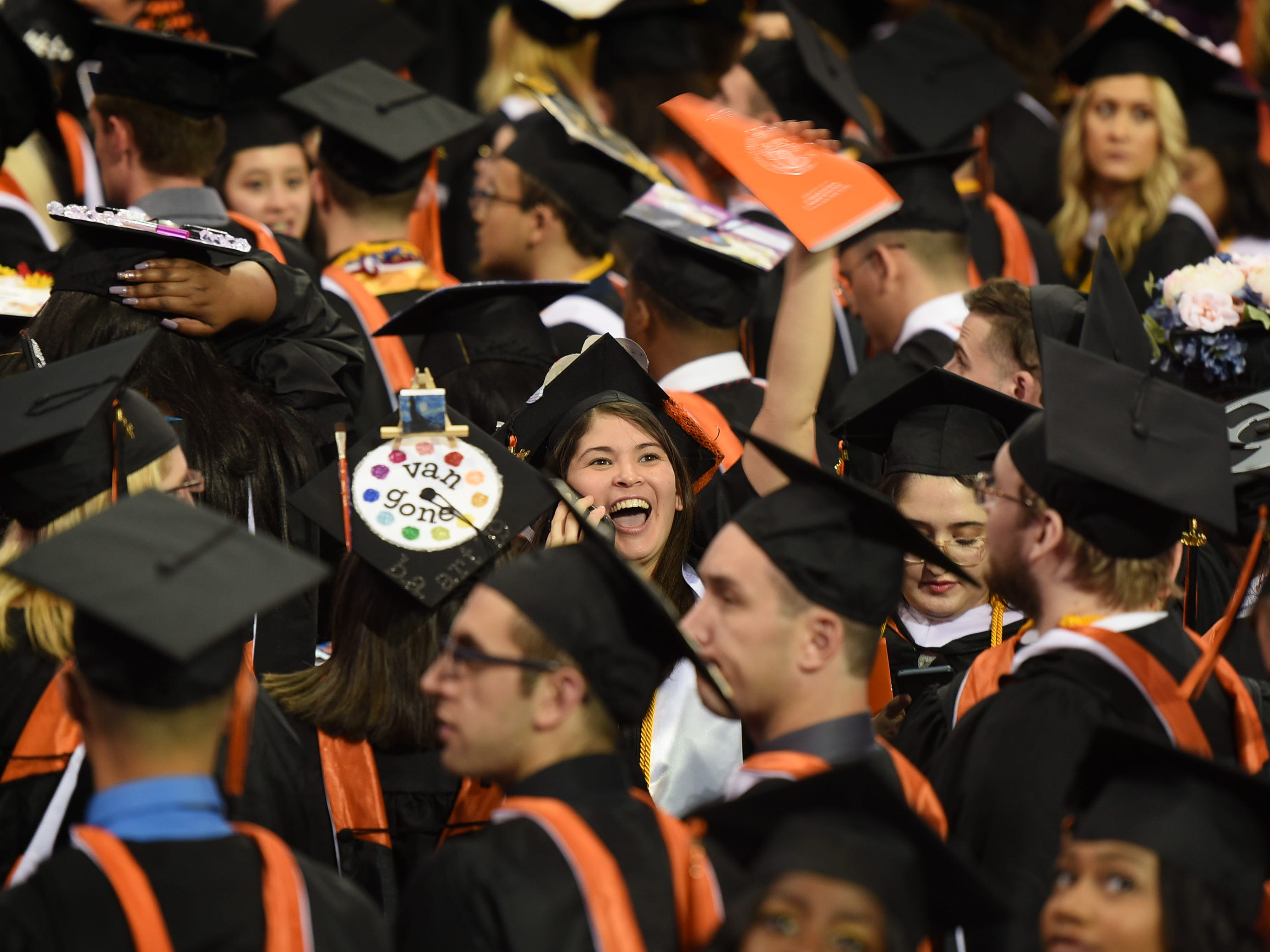 A graduate waves to members of her family at the beginning of the William Paterson University 2019 Commencement at the Prudential Center in Newark on 05/15/19.