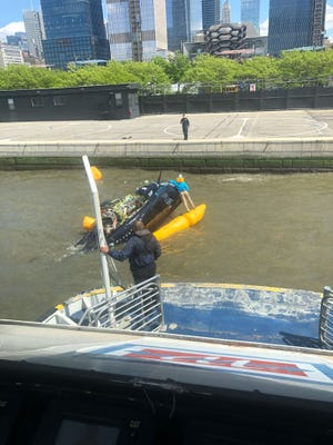A helicopter landed in the Hudson River in Manhattan