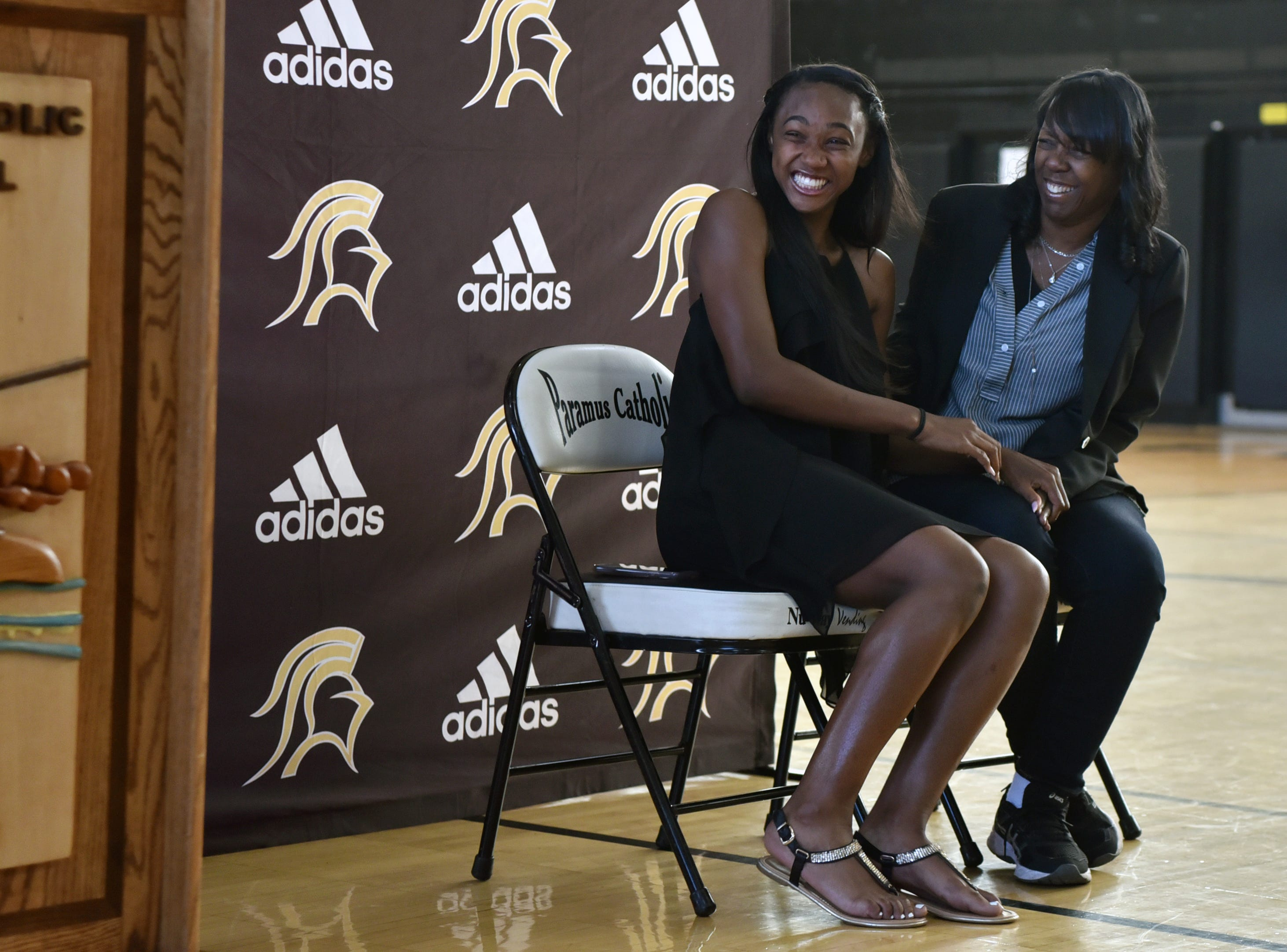 Paramus Catholic senior Kennedee Cox with her mother Beverlee Garvin, is shocked when Bob Chalfant of Foot Locker, not pictured, announces she is receiving $20,000 as part of its annual Foot Locker Scholar Athletes Program. Cox, of Teaneck, runs track at Paramus Catholic.