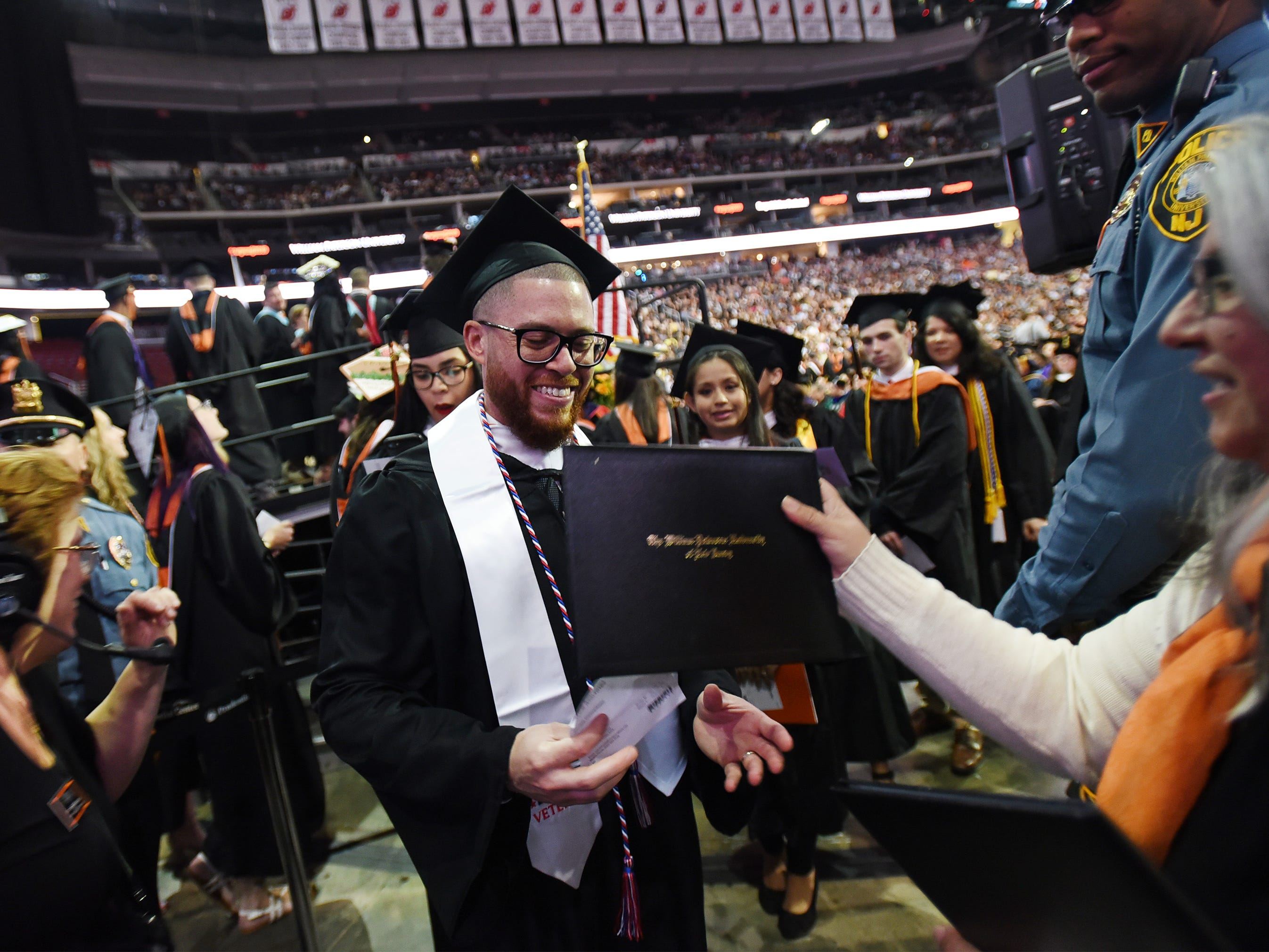 Jacob Martinez (age 36), of Weehawken, who Majored in Broadcast Journalism, an Army veteran and native of Puerto Rico, receives his degree during the William Paterson University 2019 Commencement at the Prudential Center in Newark on 05/15/19.