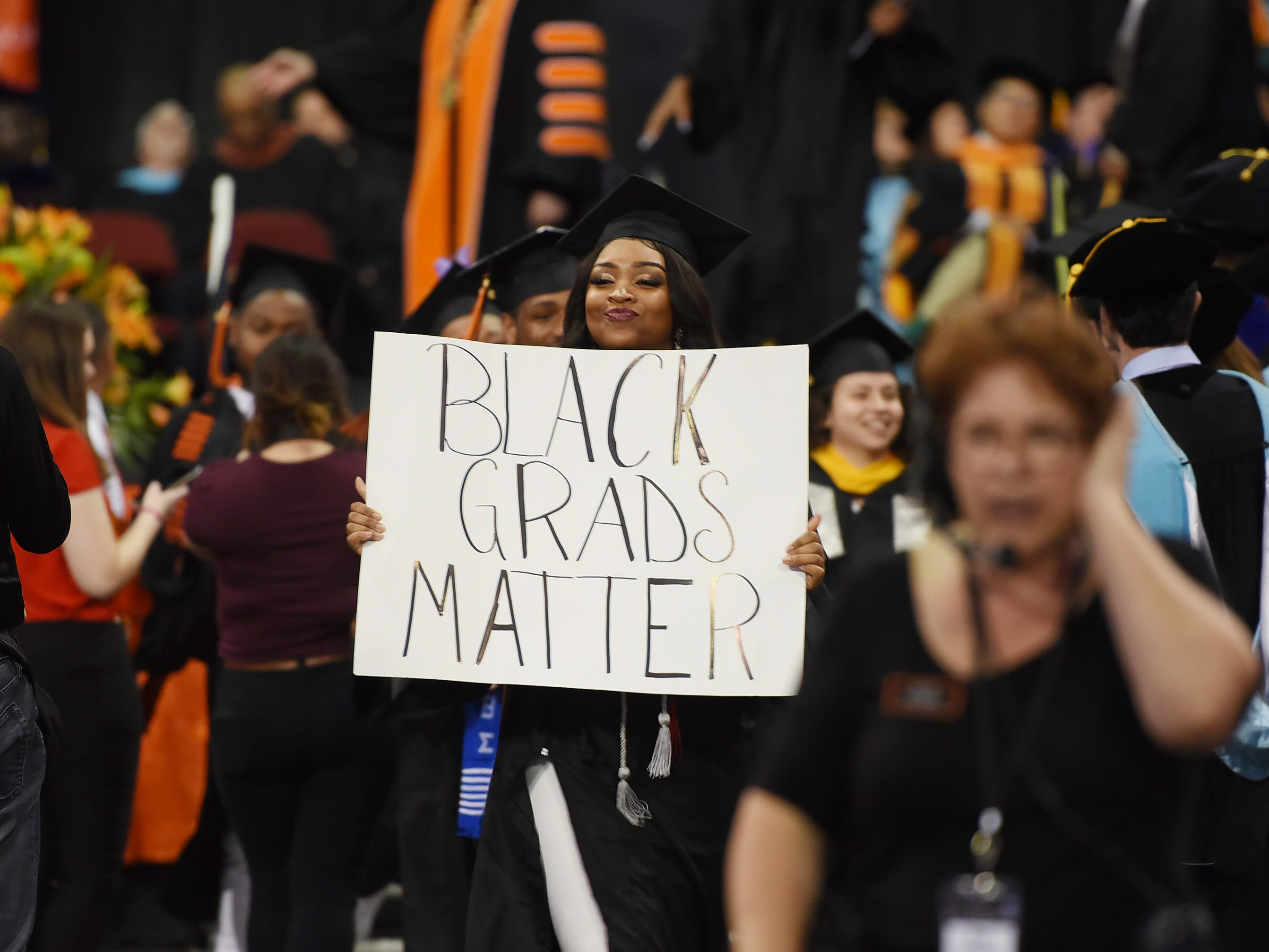 Brittany Anderson of North Caldwell, Major in Exercise Science, holds up a placard during the William Paterson University 2019 Commencement at the Prudential Center in Newark on 05/15/19.