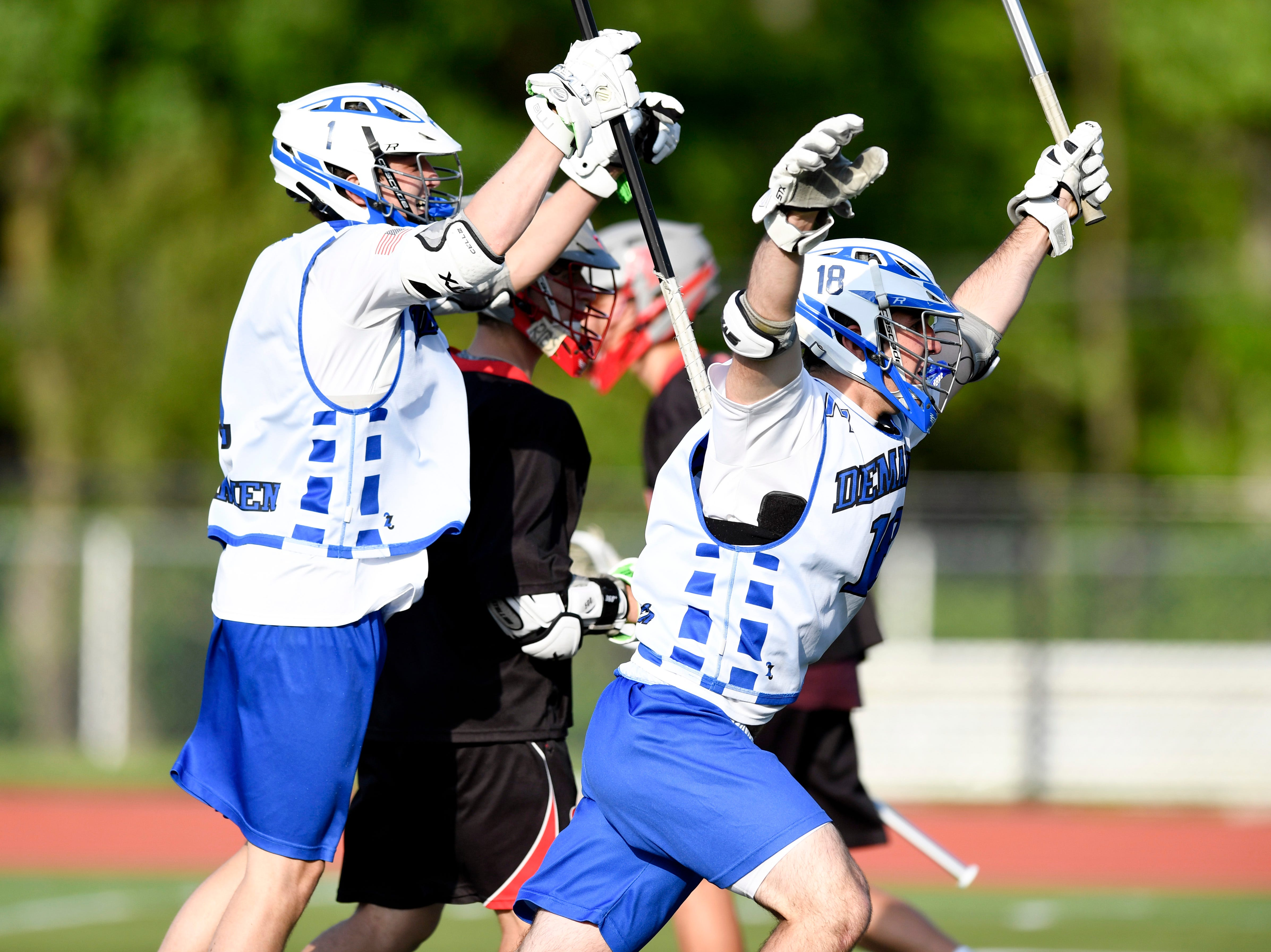Demarest's Michael Teperman, left, and Robert Kollender celebrate their 6-3 win over Lakeland in the first round of the North Group 2 boys lacrosse tournament on Wednesday, May 15, 2019 in Demarest, NJ.