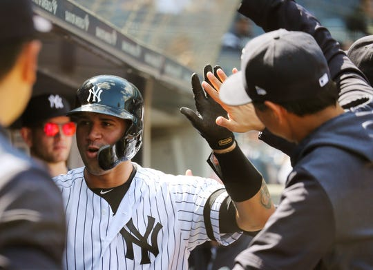 May 15, 2019; New York, NY, USA; New York Yankees catcher Gary Sanchez (24) is congratulated in the dugout after hitting a solo home run against the Baltimore Orioles during the first inning of game one of a doubleheader at Yankees Stadium.