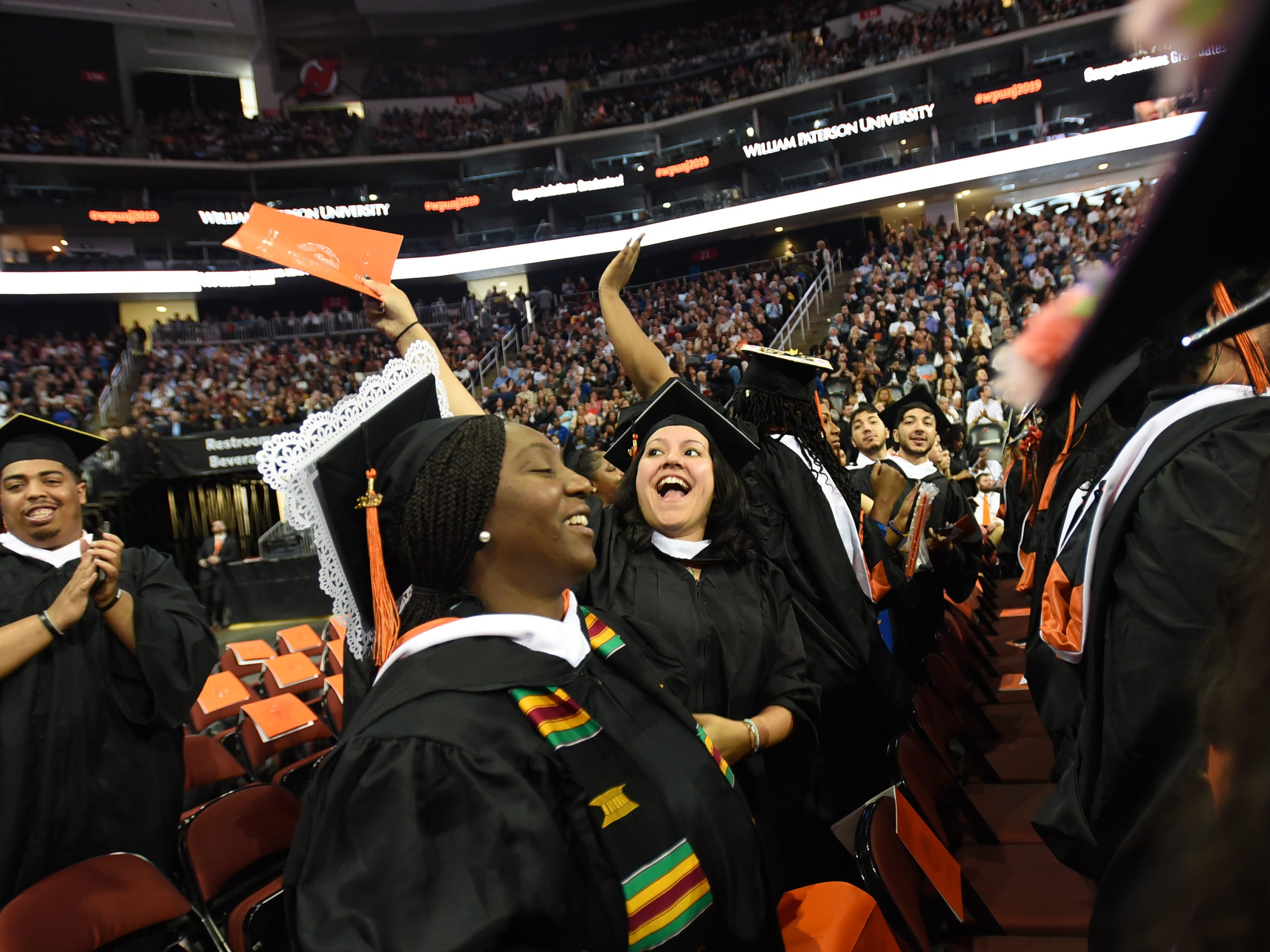 Yelitza Marie Garcia of Hawthorne, who is a Psychology Major, waves during the William Paterson University 2019 Commencement at the Prudential Center in Newark on 05/15/19.