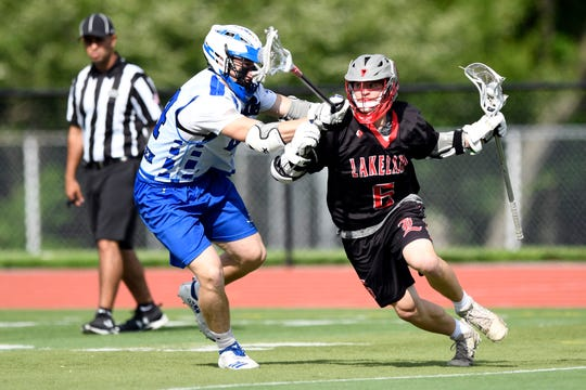 Demarest's Jack Mottola, left, puts pressure on Lakeland's J.J. Calendrillo. Northern Valley Demarest defeated Lakeland 6-3 in the first round of the North Group 2 boys lacrosse tournament on Wednesday, May 15, 2019 in Demarest, NJ.