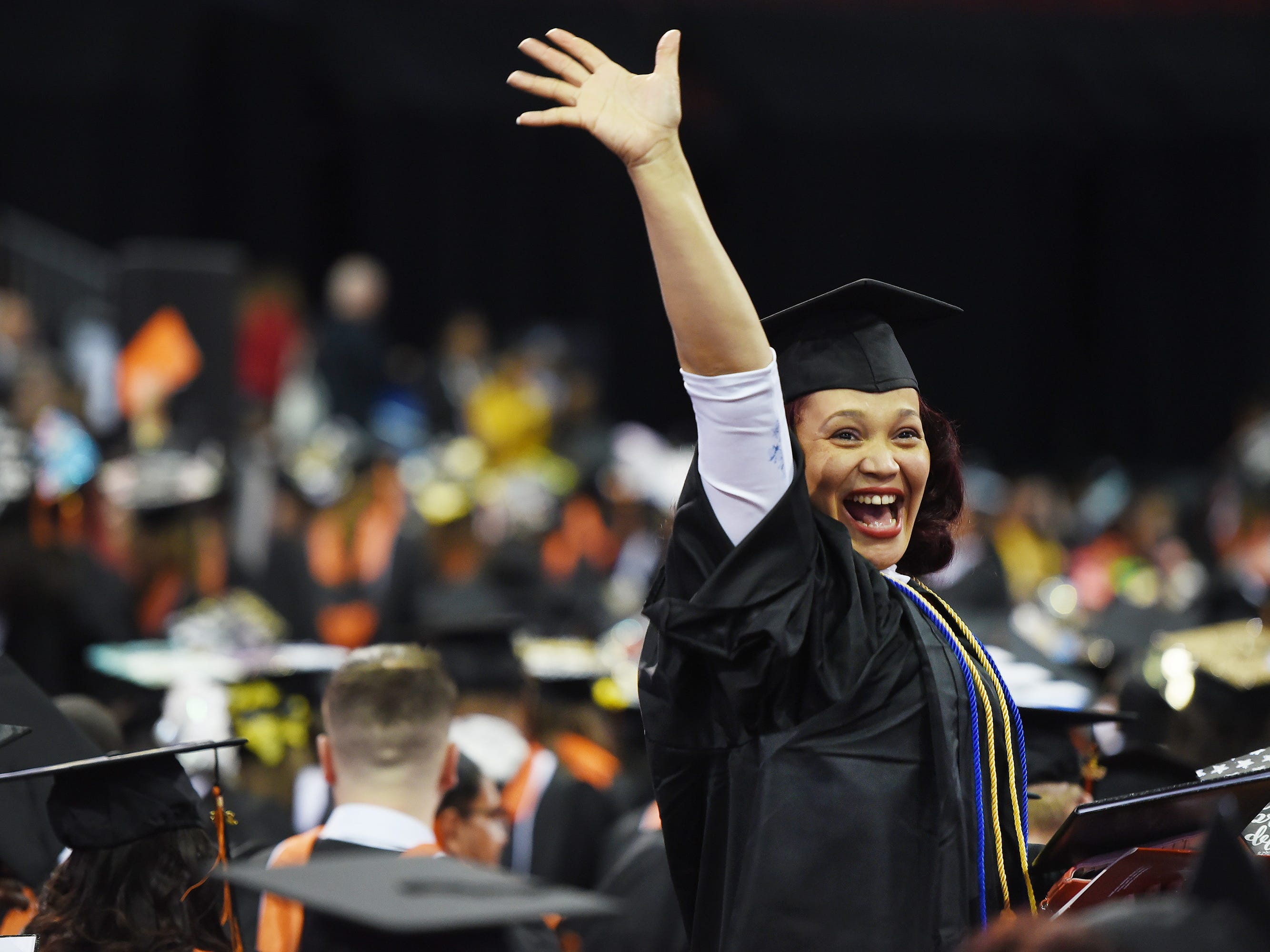 Karen Sano of Passaic, Major in Sociology, jubilantly waves during the William Paterson University 2019 Commencement at the Prudential Center in Newark on 05/15/19.