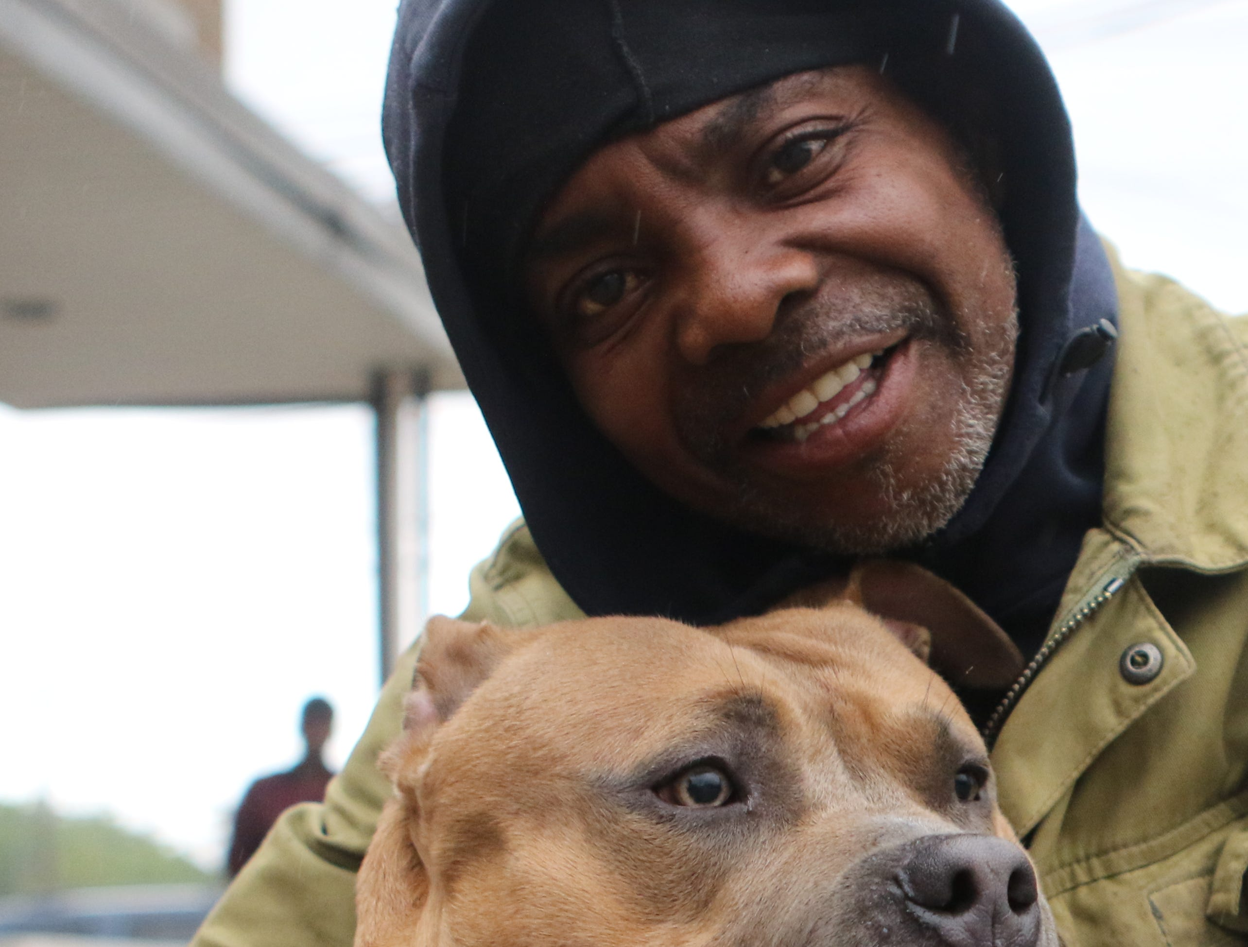 Jerome Gayden poses with Junior before getting his dog vaccinated in Paterson. People came out to the Riverside Firehouse in Paterson, Tuesday, May 14, 2019, to get free rabies vaccinations for their cats and dogs.  The 44th annual clinic continues Thursday at 128 Getty Ave. and Friday at 300 McBride Ave. from 7-8pm.  It concludes over the weekend, Saturday from 12:30-1:30pm at Firehouse No.4 on Temple St.  Sunday it is back at Riverhouse Firehouse at East 16th St. and Lafayette from 10:30 until noon.