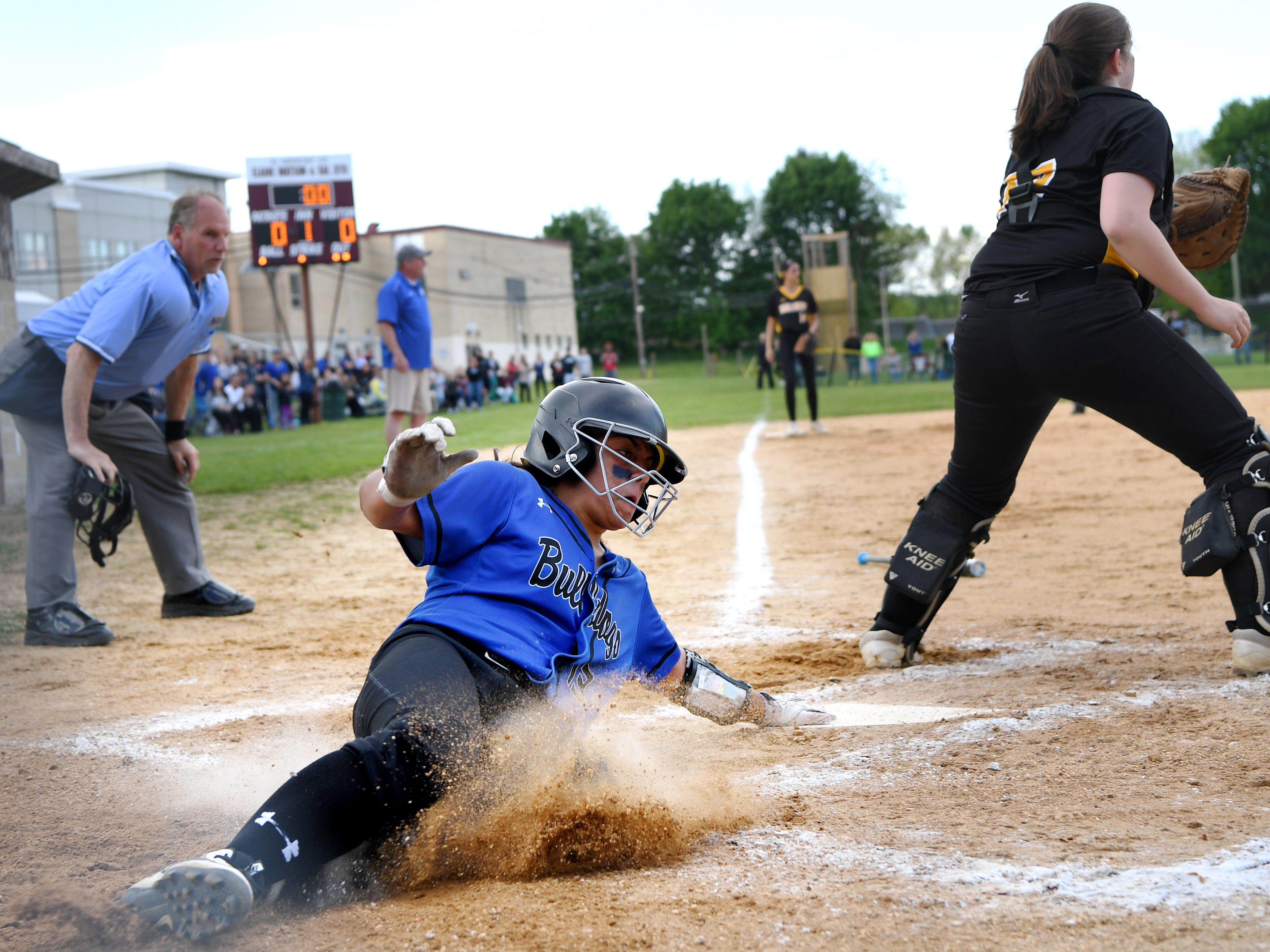 Passaic County Technical Institute vs. West Milford in the Passaic County Tournament softball final at Wayne Hills High School on Wednesday, May 15, 2019. PCTI #13 Daniela Vidal slides and is safe at home.