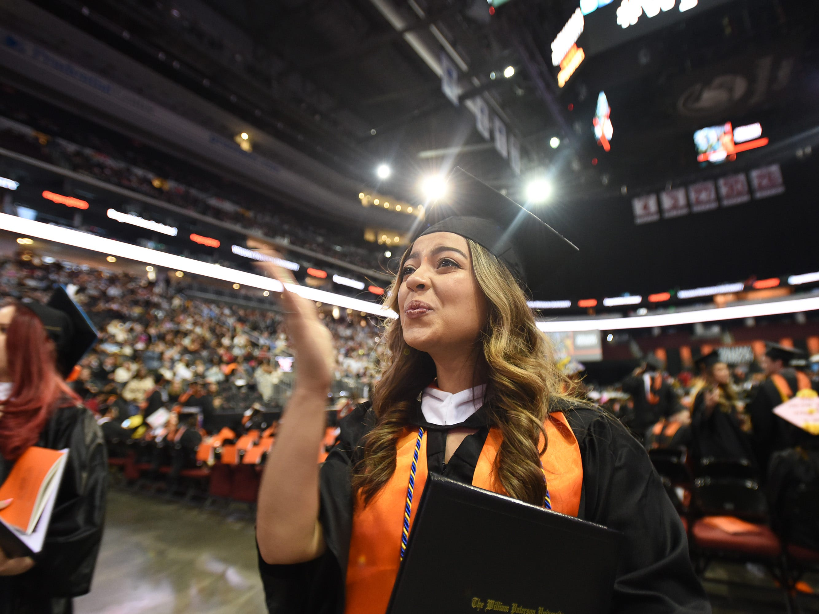 Tiffany Gonzalez of Paterson, Major in Psychology, blows a kiss after receiving her degree during the William Paterson University 2019 Commencement at the Prudential Center in Newark on 05/15/19.