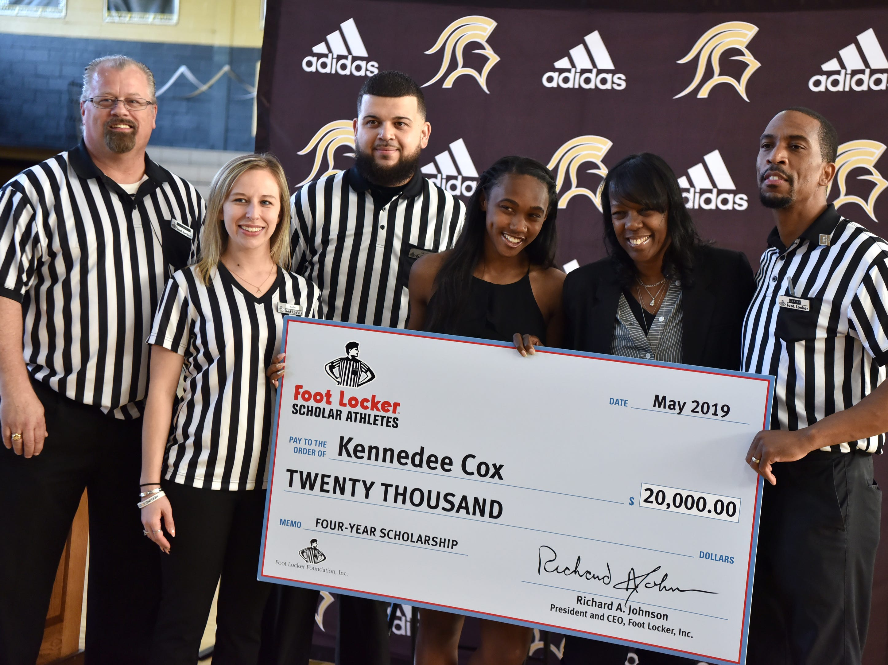 Paramus Catholic senior Kennedee Cox and her mother Beverlee Garvin, pose for pictures with a $20,000 check Cox received from the Foot Locker Scholar Athletes Program. Cox, of Teaneck, runs track at Paramus Catholic. Foot Locker representatives surprised Cox with the announcement at school on Wednesday, May 15, 2019.