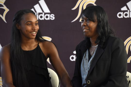 Paramus Catholic senior Kennedee Cox and her mother Beverlee Garvin wait for Foot Locker representative to announce she is receiving $20,000 as part of its annual Foot Locker Scholar Athletes Program. Cox, of Teaneck, runs track at Paramus Catholic.