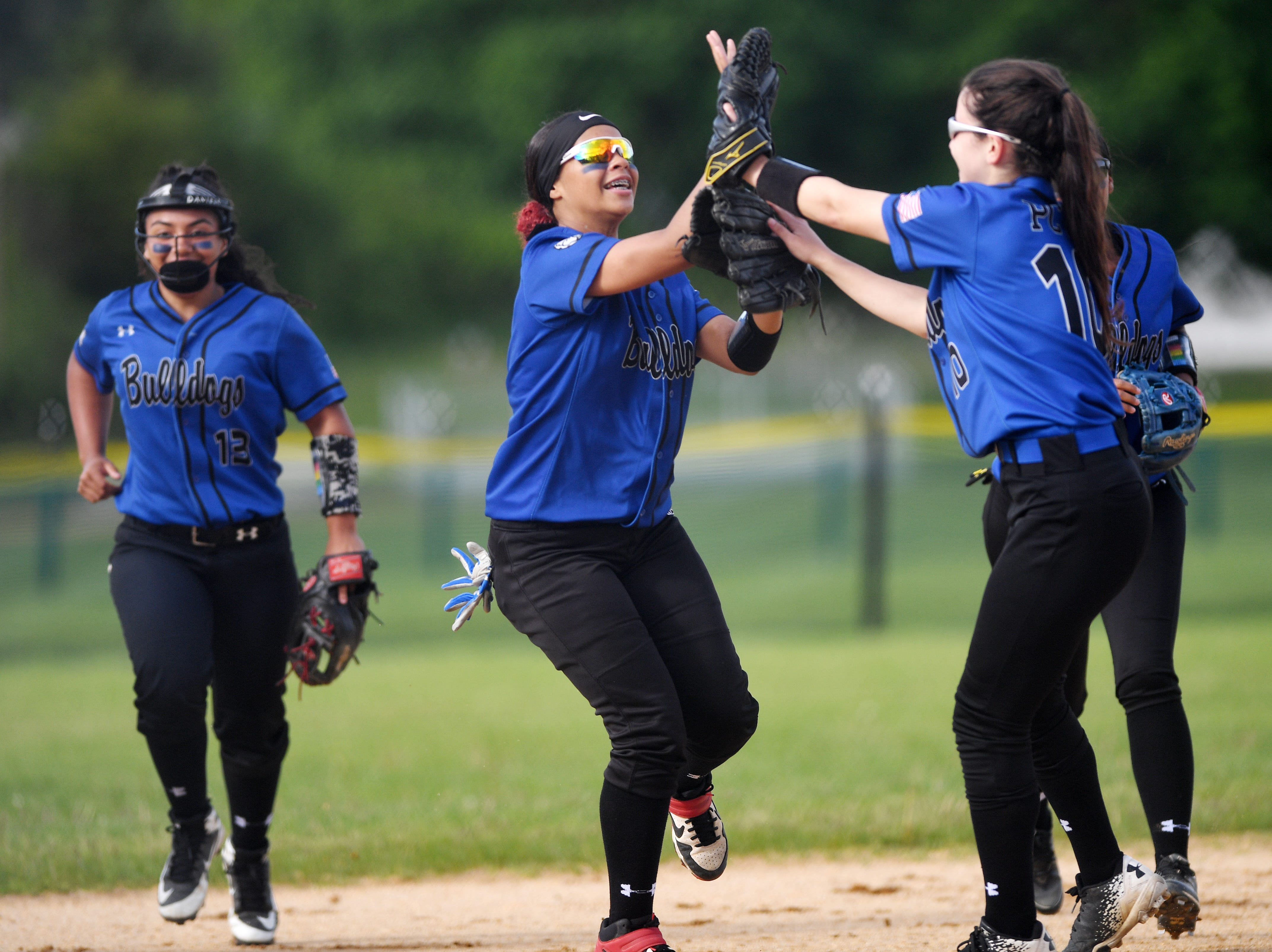Passaic County Technical Institute vs. West Milford in the Passaic County Tournament softball final at Wayne Hills High School on Wednesday, May 15, 2019. PCTI  #1 Alana Roberts celebrates after making a catch in the outfield. (right) PCTI #10 Alexa Conklin.