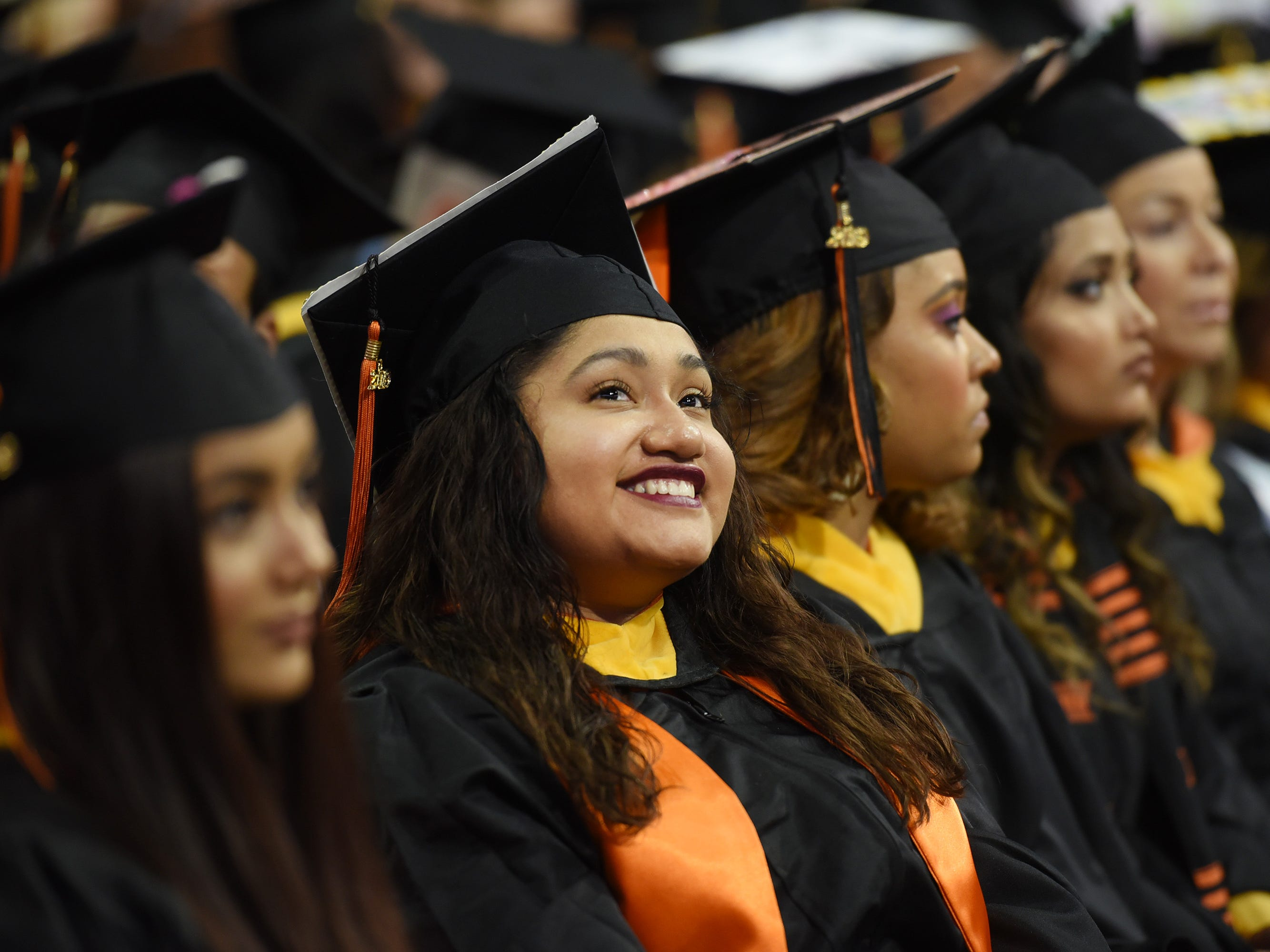 A graduate smiles during the William Paterson University 2019 Commencement at the Prudential Center in Newark on 05/15/19.