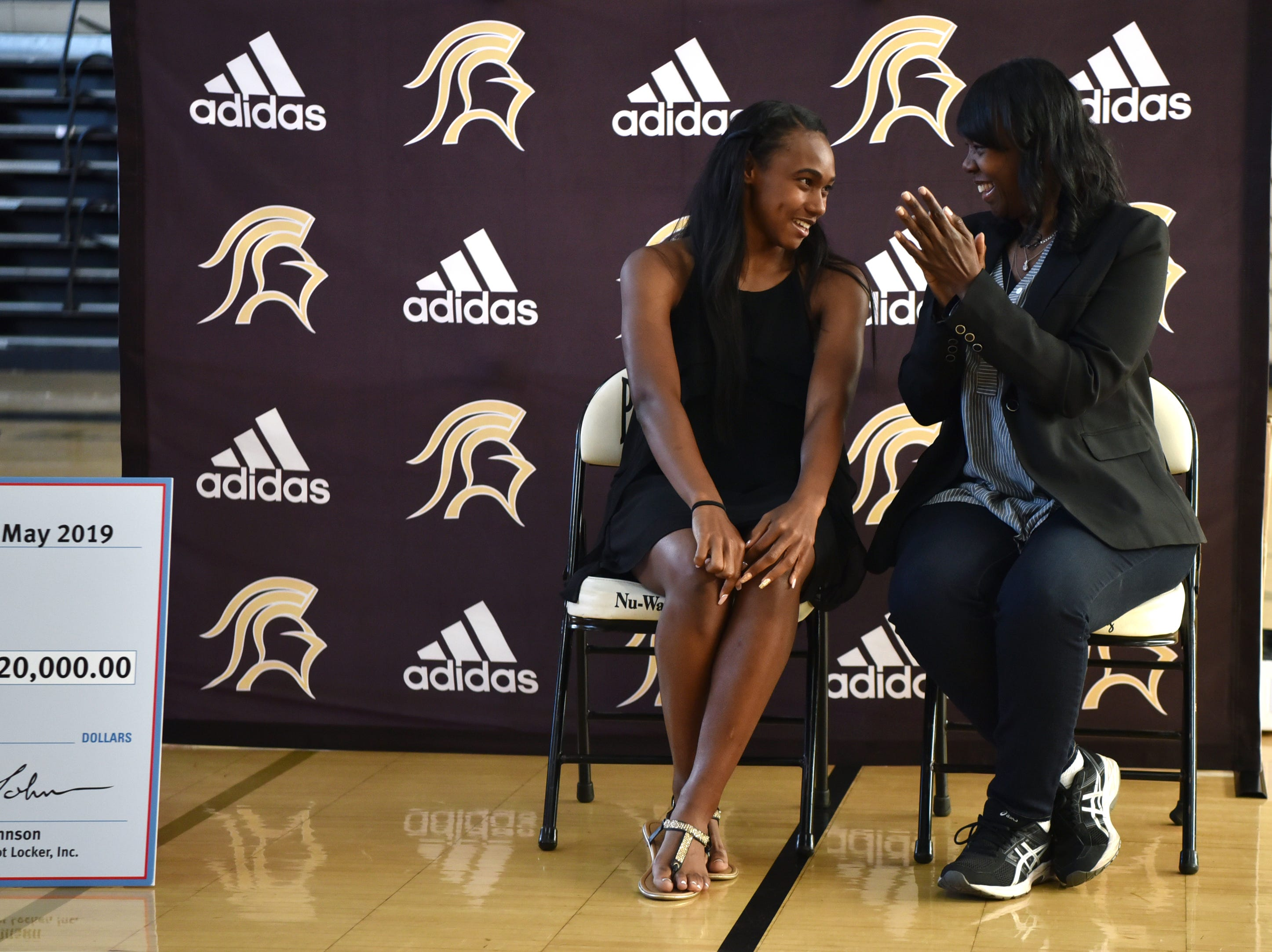 Paramus Catholic senior Kennedee Cox and her mother Beverlee Garvin, and enjoy the moment after Cox receives $20,000 from the Foot Locker Scholar Athletes Program. Cox, of Teaneck, runs track at Paramus Catholic and  Foot Locker representatives surprised Cox with the announcement at school on Wednesday, May 15, 2019.