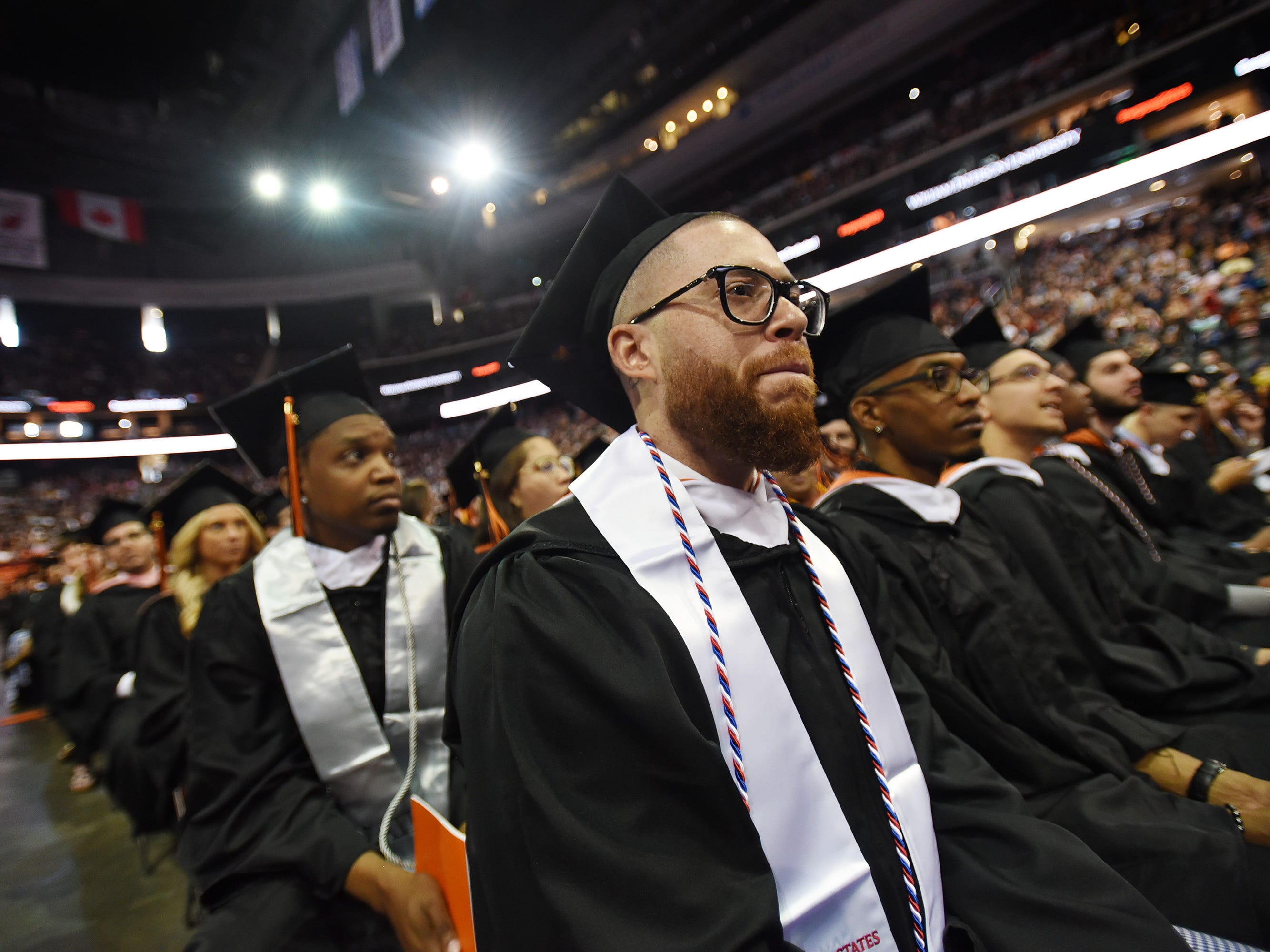 Jacob Martinez (age 36), of Weehawken, who Majored in Broadcast Journalism, an Army veteran and native of Puerto Rico, listens during the William Paterson University 2019 Commencement at the Prudential Center in Newark on 05/15/19.