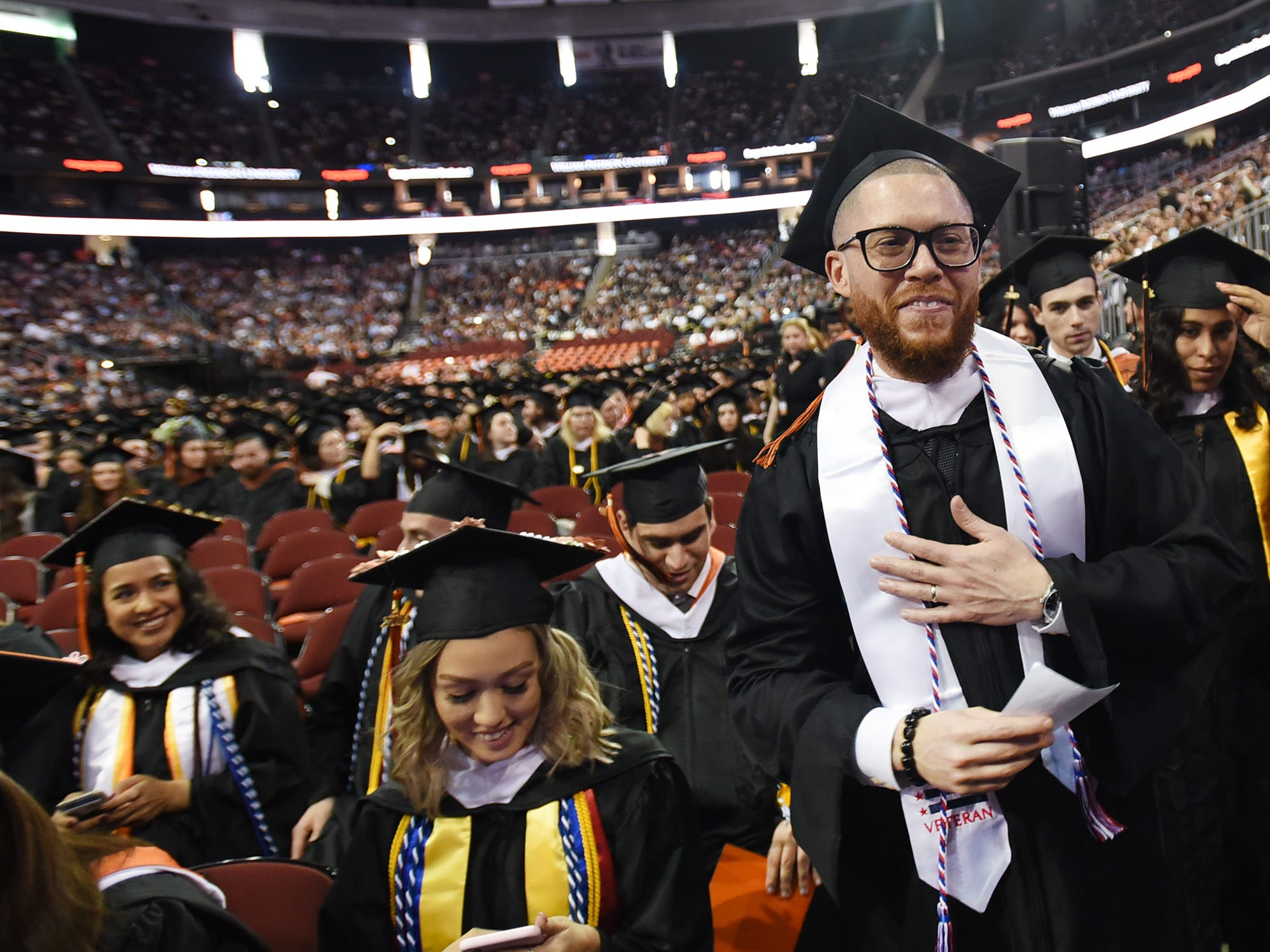 Jacob Martinez (age 36), of Weehawken, who Majored in Broadcast Journalism, an Army veteran and native of Puerto Rico, stands in line to receive his degree during the William Paterson University 2019 Commencement at the Prudential Center in Newark on 05/15/19.