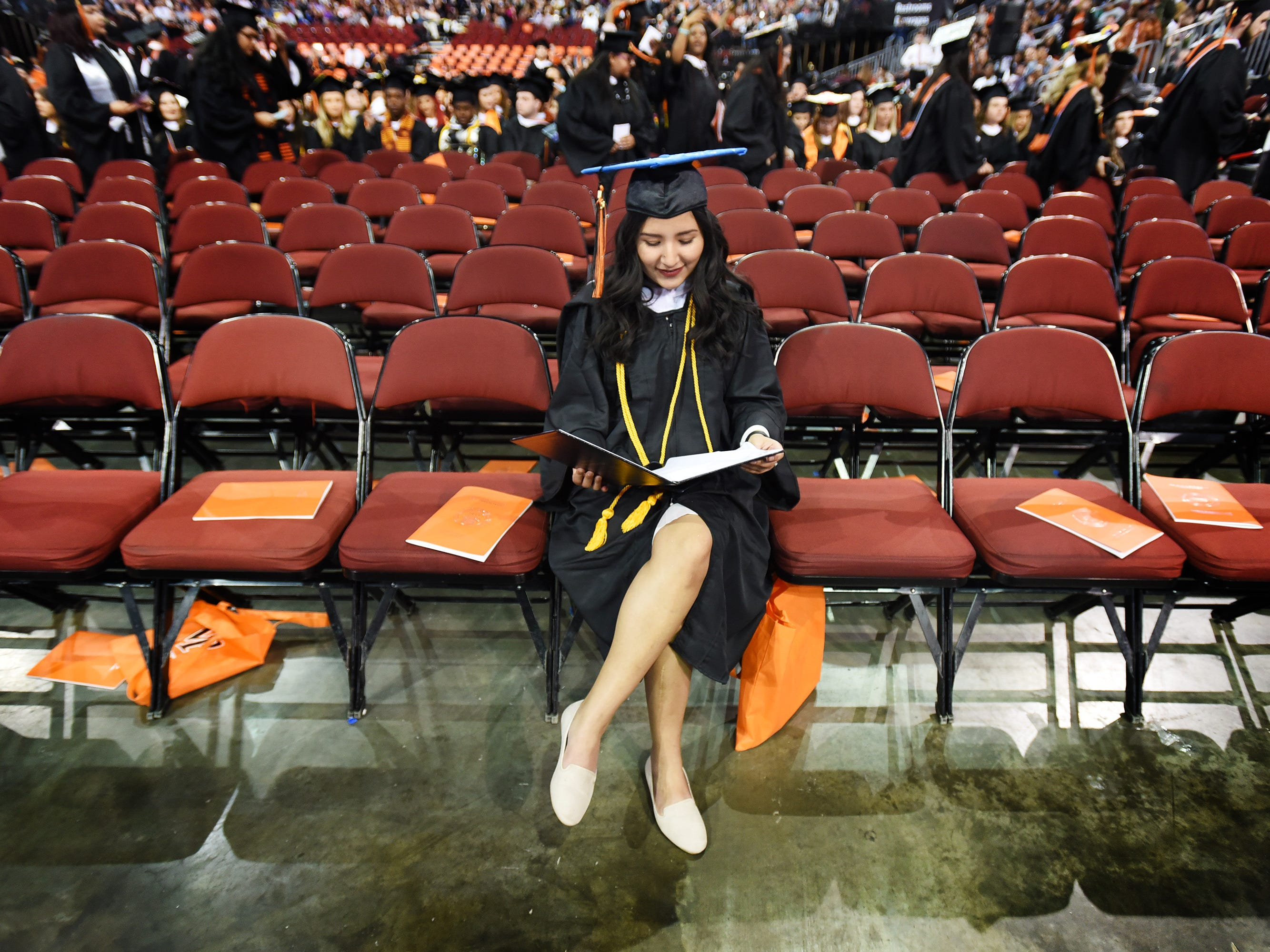 Denise Castillo of Paterson, Major in Communication Media Production, sits alone as she looks at her degree during the William Paterson University 2019 Commencement at the Prudential Center in Newark on 05/15/19.