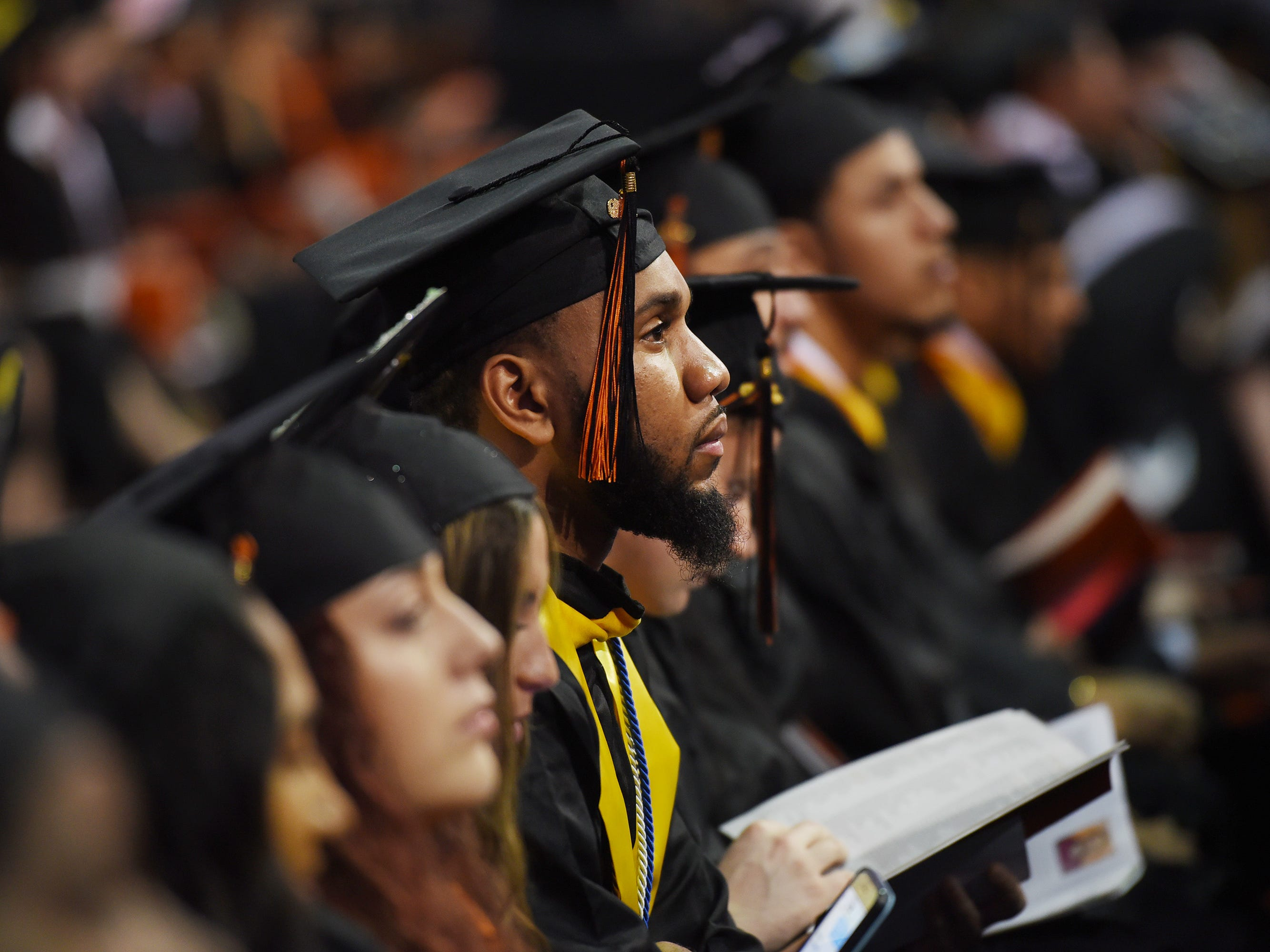 Graduates listen during the William Paterson University 2019 Commencement at the Prudential Center in Newark on 05/15/19.