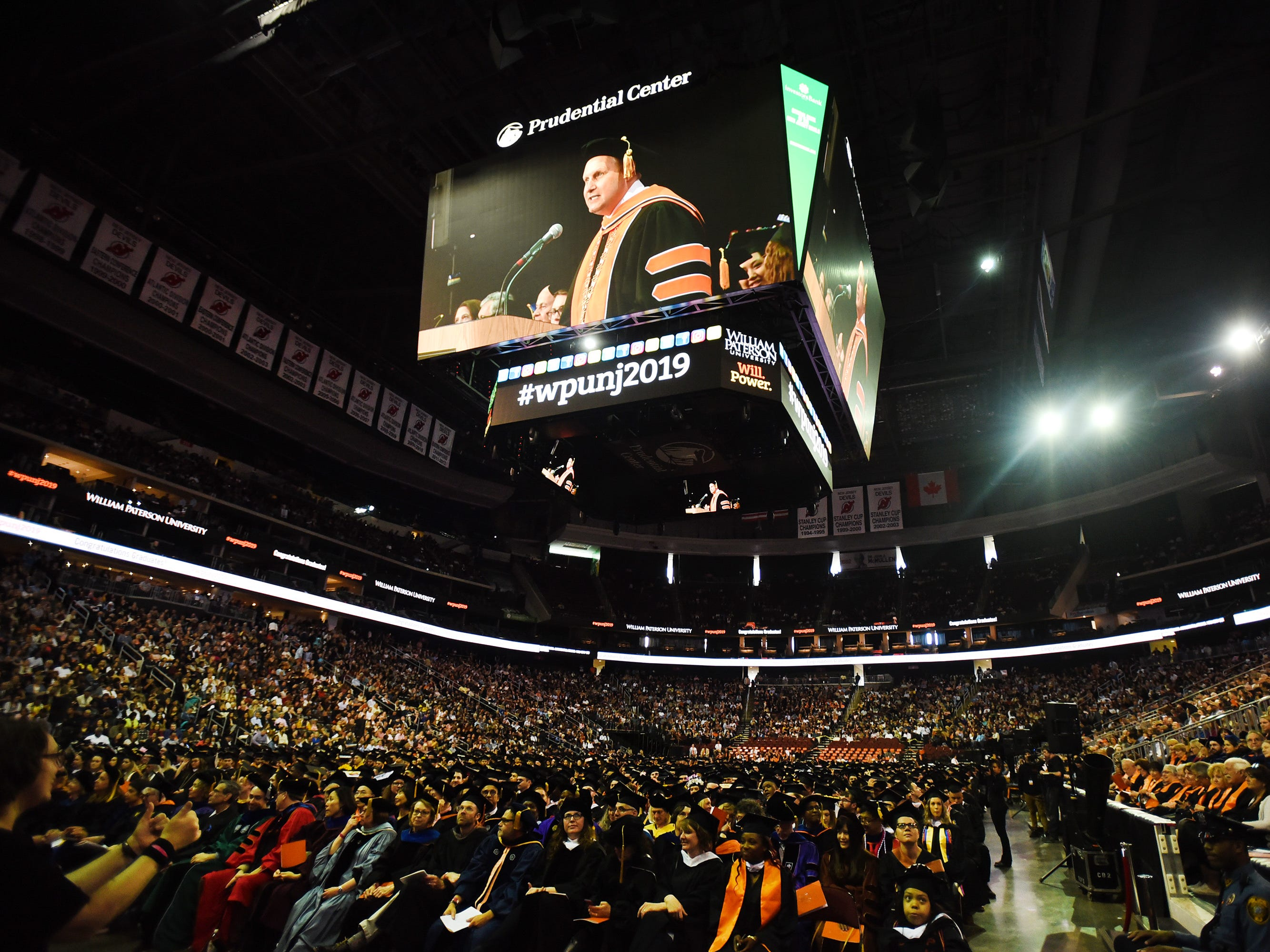 Richard J. Helldobler, PhD, President of the University, is seen on the overhead screen as he gives a a speech during the William Paterson University 2019 Commencement at the Prudential Center in Newark on 05/15/19.