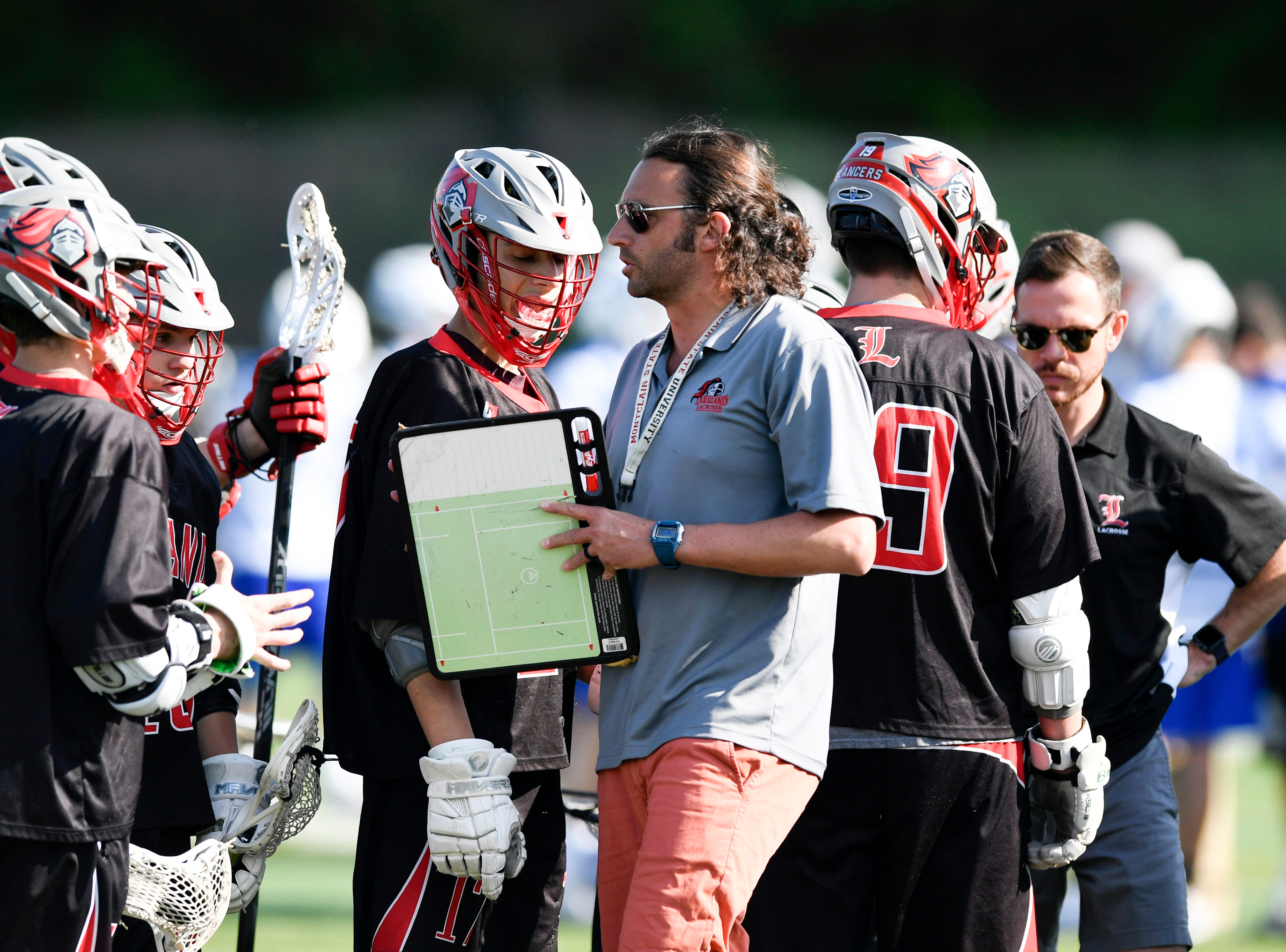 Lakeland head coach Jesse Kolodin talk to his team during a time out. Northern Valley Demarest defeated Lakeland 6-3 in the first round of the North Group 2 boys lacrosse tournament on Wednesday, May 15, 2019 in Demarest, NJ.